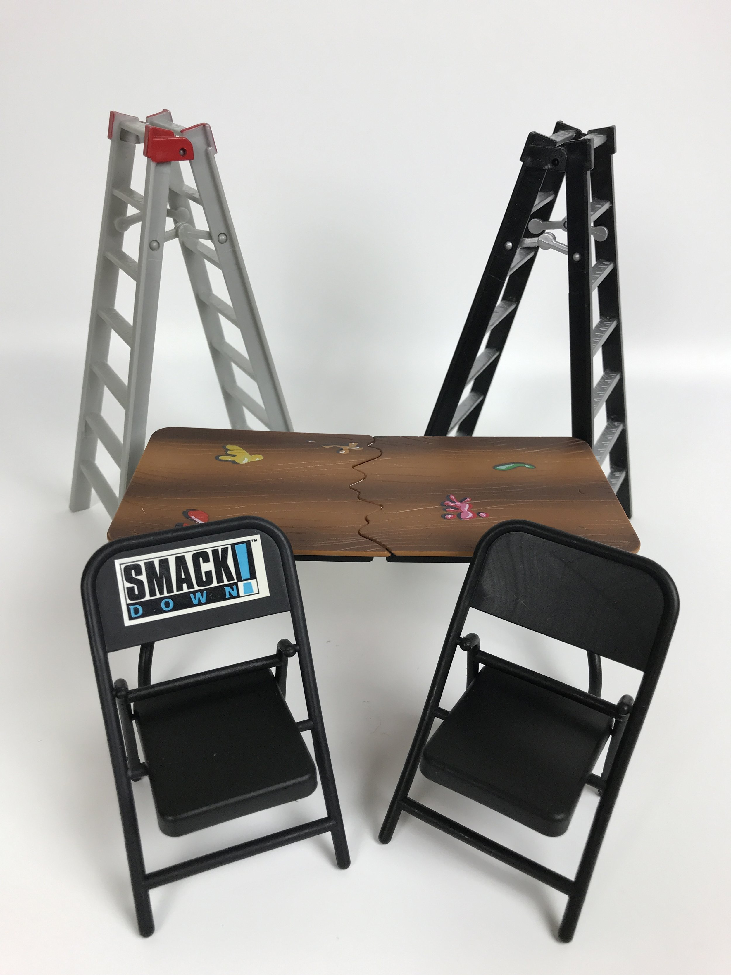 WWE table, ladders, and chairs