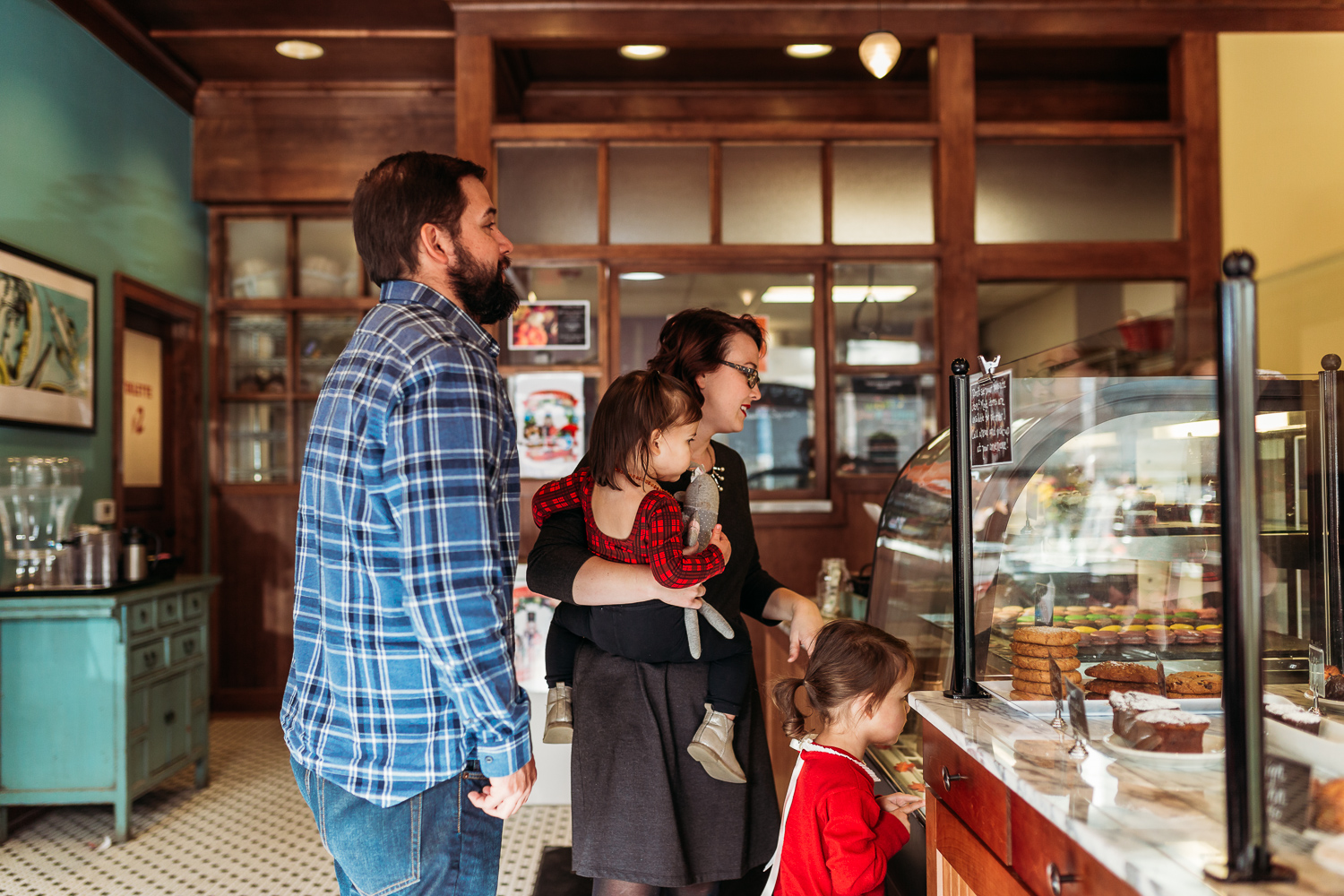 family in bakery in wauwatosa, wisconsin making choices
