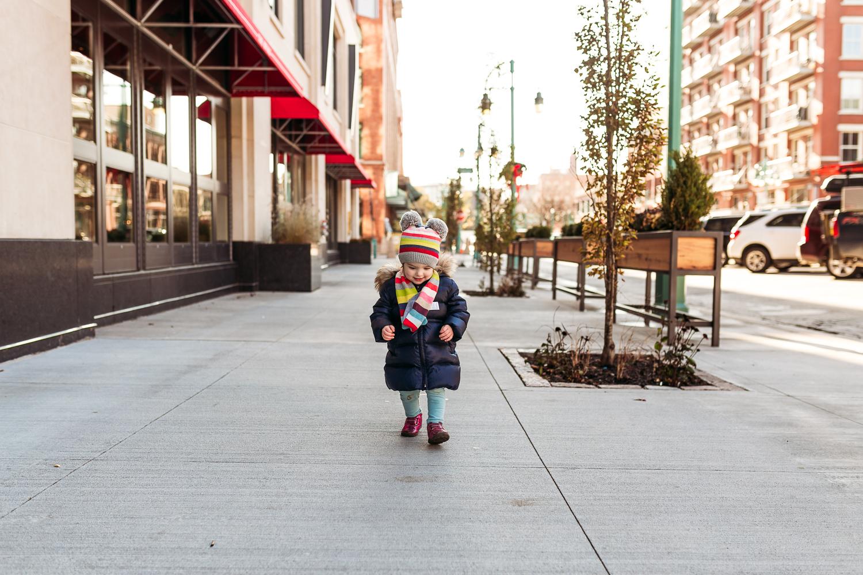 Little girl walking in Milwaukee's third ward.