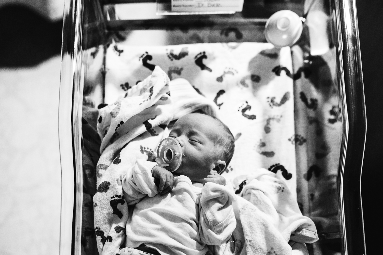 Newborn in hospital crib