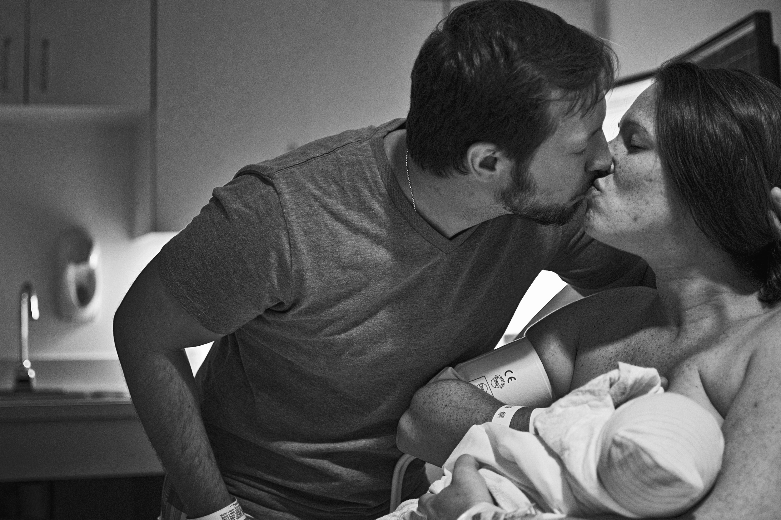 Richmond Birth Photographer - The we did it kiss once baby is in mom's arms