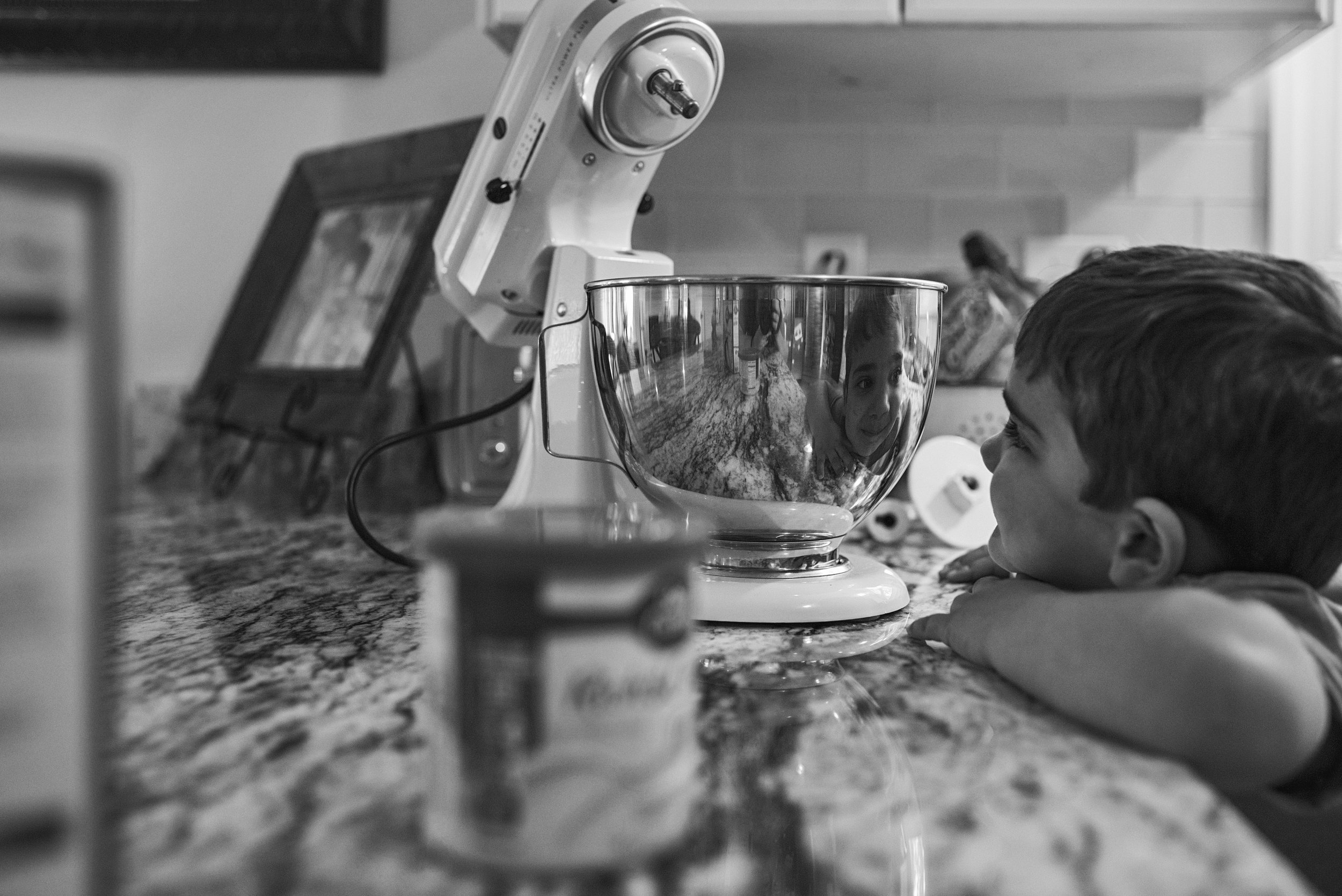 Mechanicsville family decided to bake cupcakes for a local fire department during their family session and the little boy enjoyed watching he reflection in the mixer.