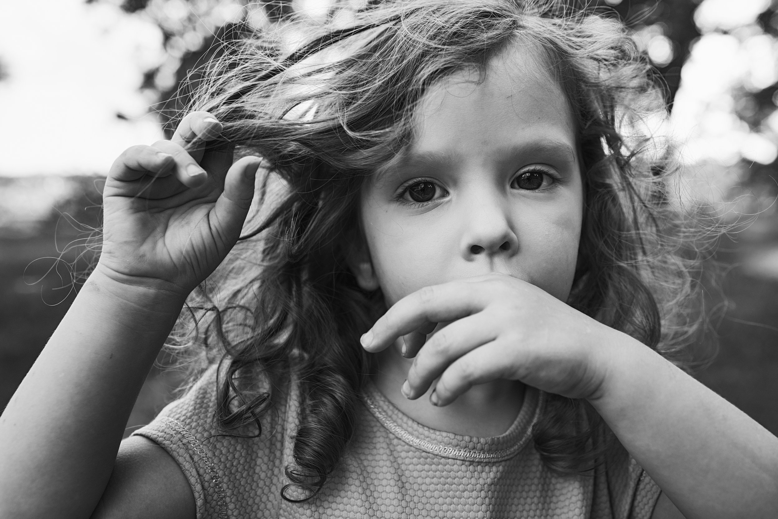 As a parent and photographer, Nicoleinbold looks to capture the moments we hope to hold onto forever like the way this girl twirls her hair while she sucks her thumb.