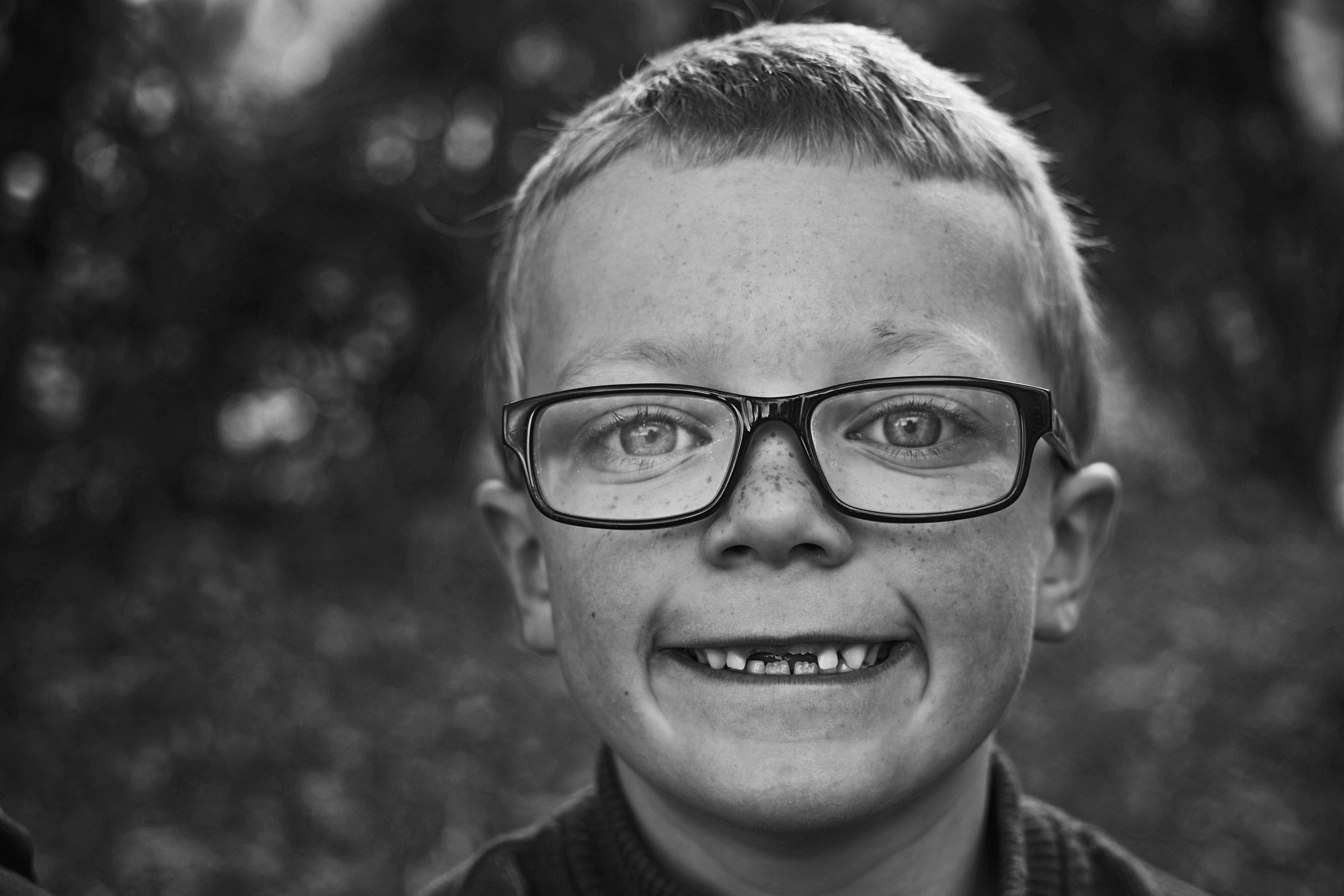 Portraits of kids can document growth like missing teeth as seen in the picture of a Richmond native boy.