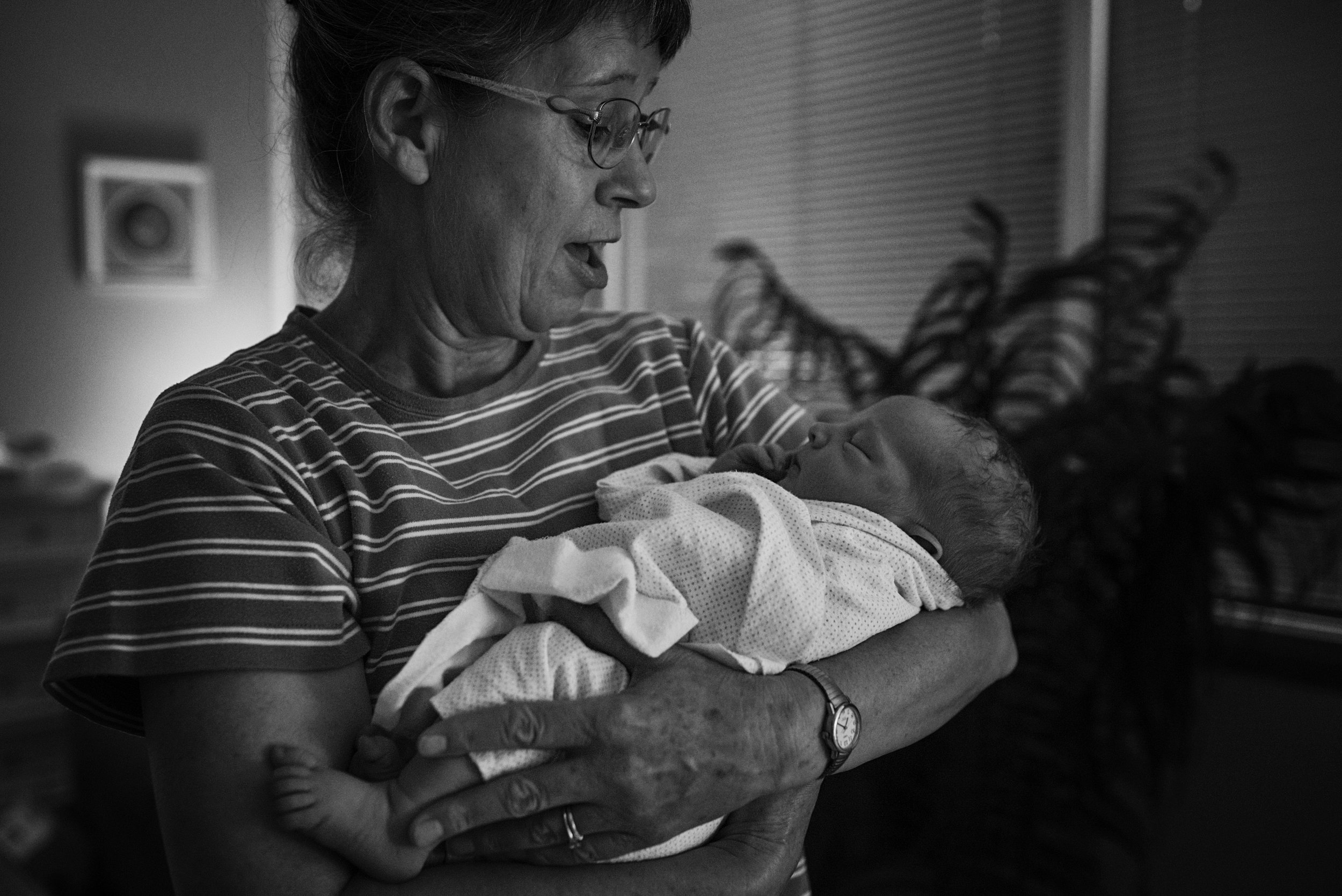 Grandma holding her newest grandson after a fast labor and delivery by a Richmond mom and dad.