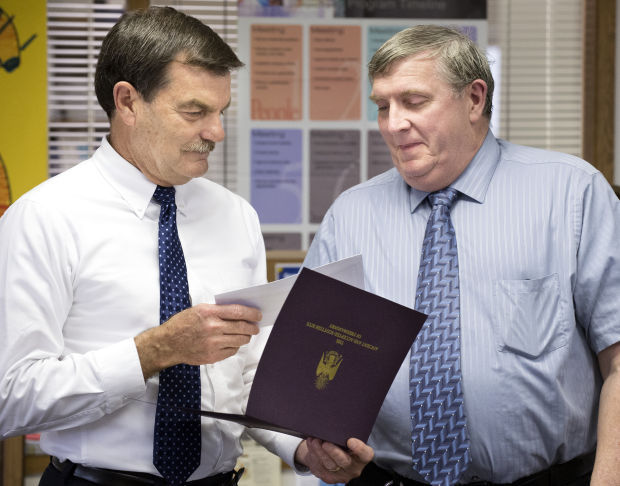 2014 Teacher of the Year award with Tom Greenlee.jpg