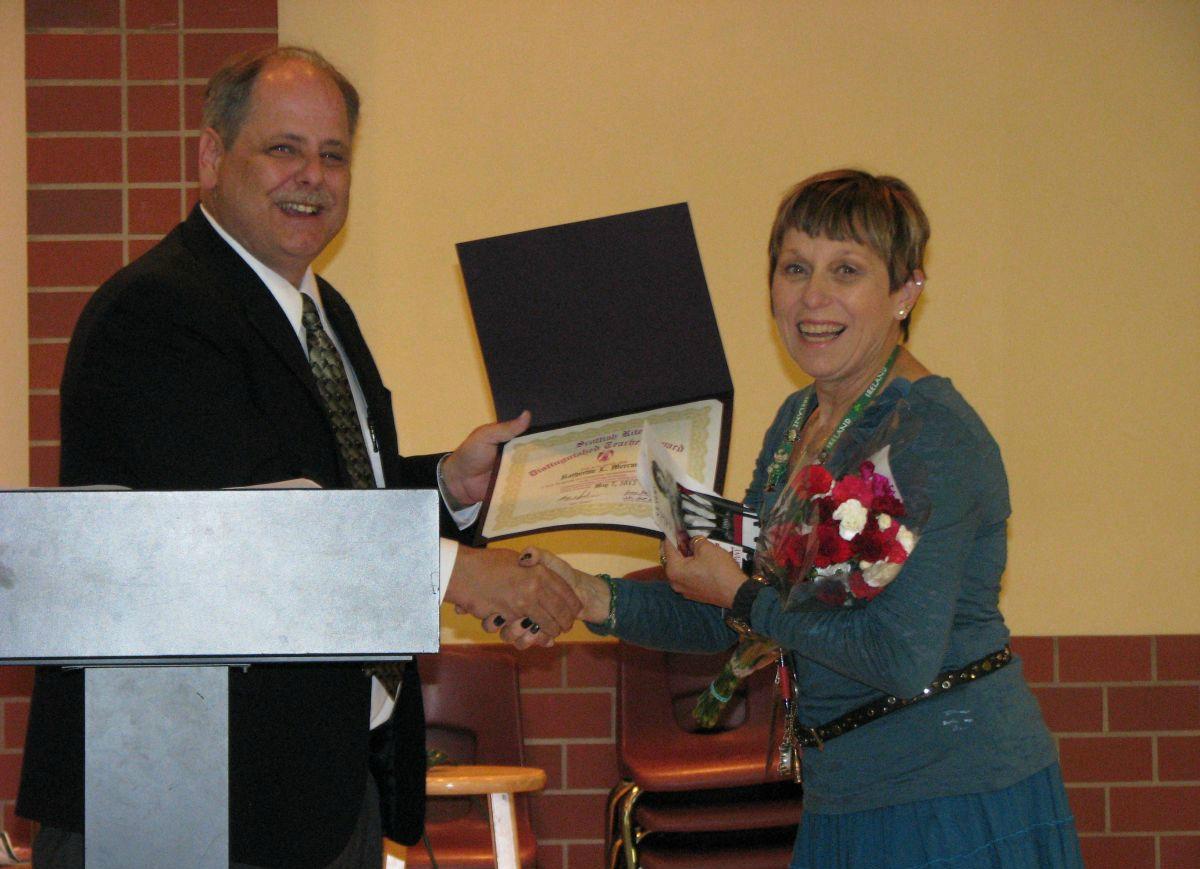 2012 Teacher of the Year award with Scott Dodge.jpg