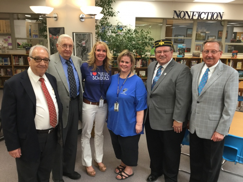 Teacher of the Year Jan McKeown with Bruce Wood, Jerry Pigsley, and Mike Gray