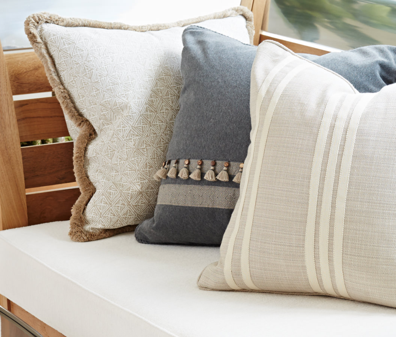 8. pillows made up with beautiful outdoor fabric give you a no-fuss soft place to land