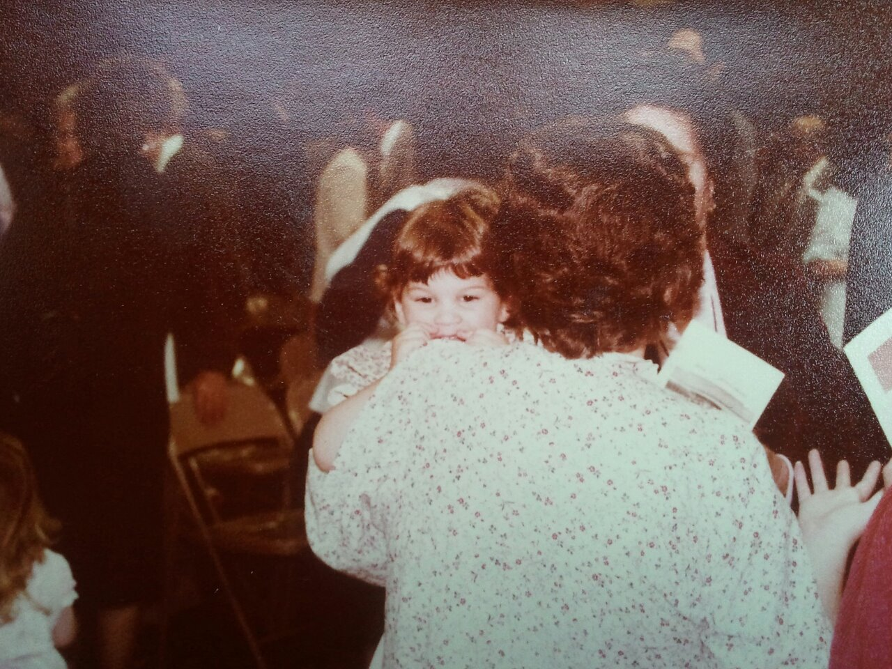 This moment matters to me.  That is me as a young girl being held by my mom.  I love it beacuse even though it's the back of her head, her hand gesture says it all to me and reminds me that she loved friends and a good conversation.  I don't know who took this photograph and it's a small miracle that I have it, but I am so very glad they did!  My mother passed away in 2001.