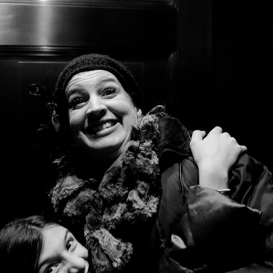 Me and my daughter goofing off in an elevator while my son took the photo.  I love it!  It captures our relationship.