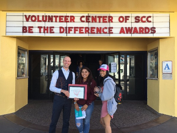 """FoodWhat youth leaders, Abi and Iris, join Executive Director Doron Comerchero to receive a """"  Be the Difference""""Award recognizing the """"Top 50 People, Groups and Businesses who do the most to transform Santa Cruz County through volunteerism.""""   FoodWhat received special honors at the recent 2017 Awards Gala as one of five outstanding nominees from the top 50 volunteer champions."""