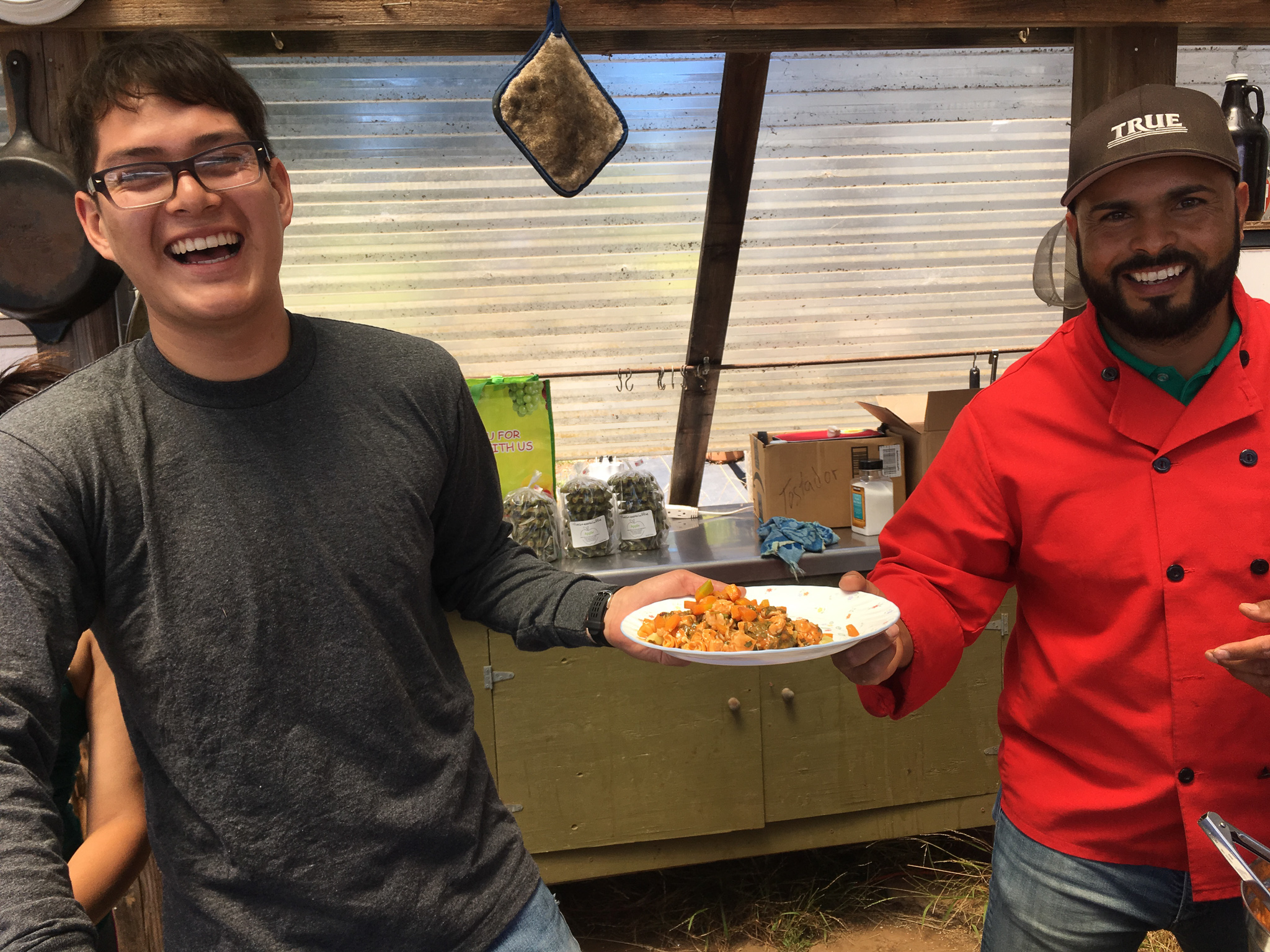 Junior Staff Aurelio dishing up lunch with Guest Chef Martin Madriz from The Green Waffle!   Each week, half the crew got to work with professional chefs from Watsonville to Santa Cruz to make an outstanding lunch for the other half of the crew.