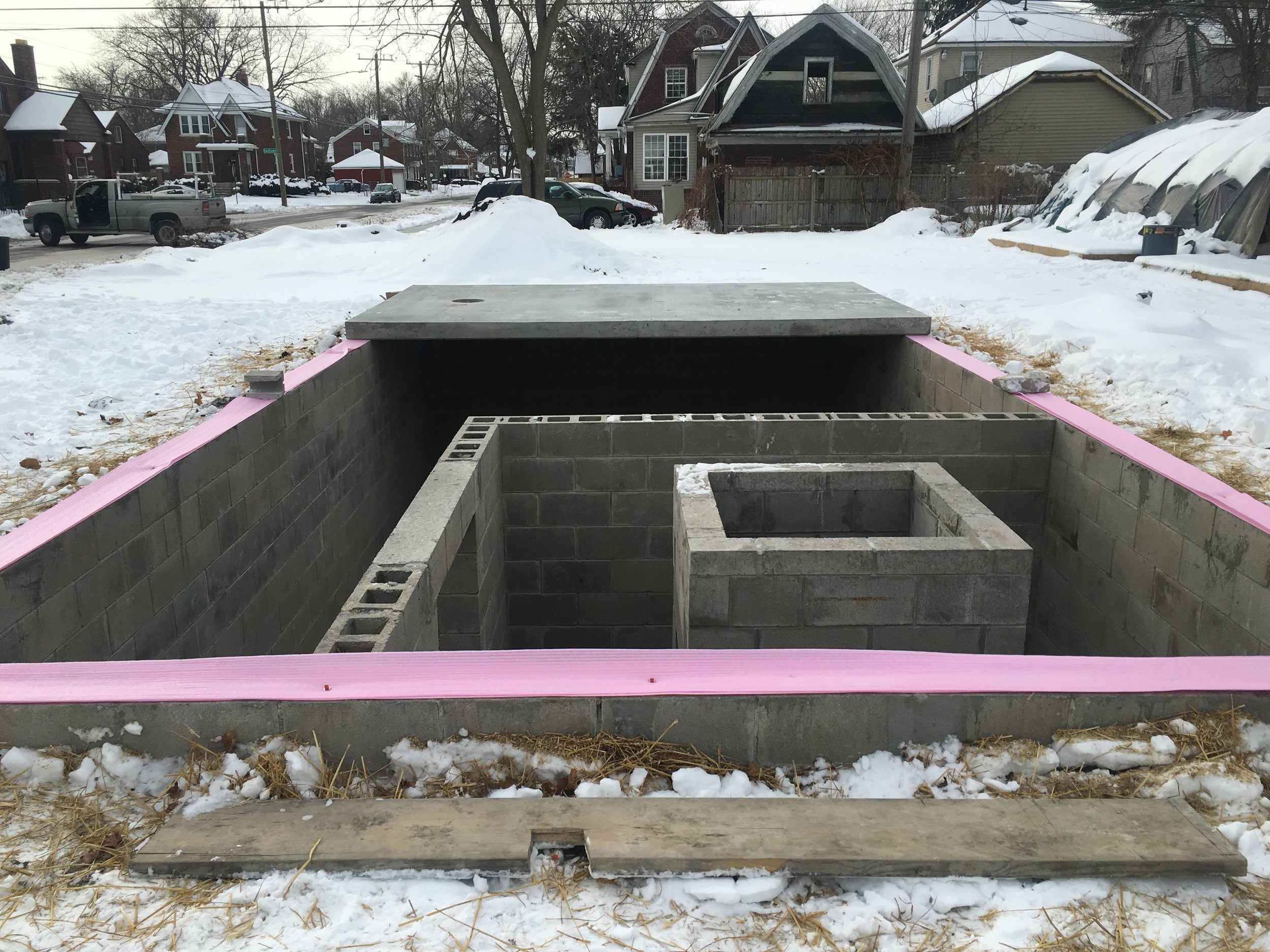 The shaft on the right is built to accommodate a manual dumb-waiter that will extend from the top of the root cellar to the top of the hoop house. It will be used to lower and raise boxes of dahlia tubers. There will also be a three tier staircase built around the dumb-waiter staff. Then there is an inner door where that leads to the main chamber where the boxes of tubers will be stored on shelves that line the walls.