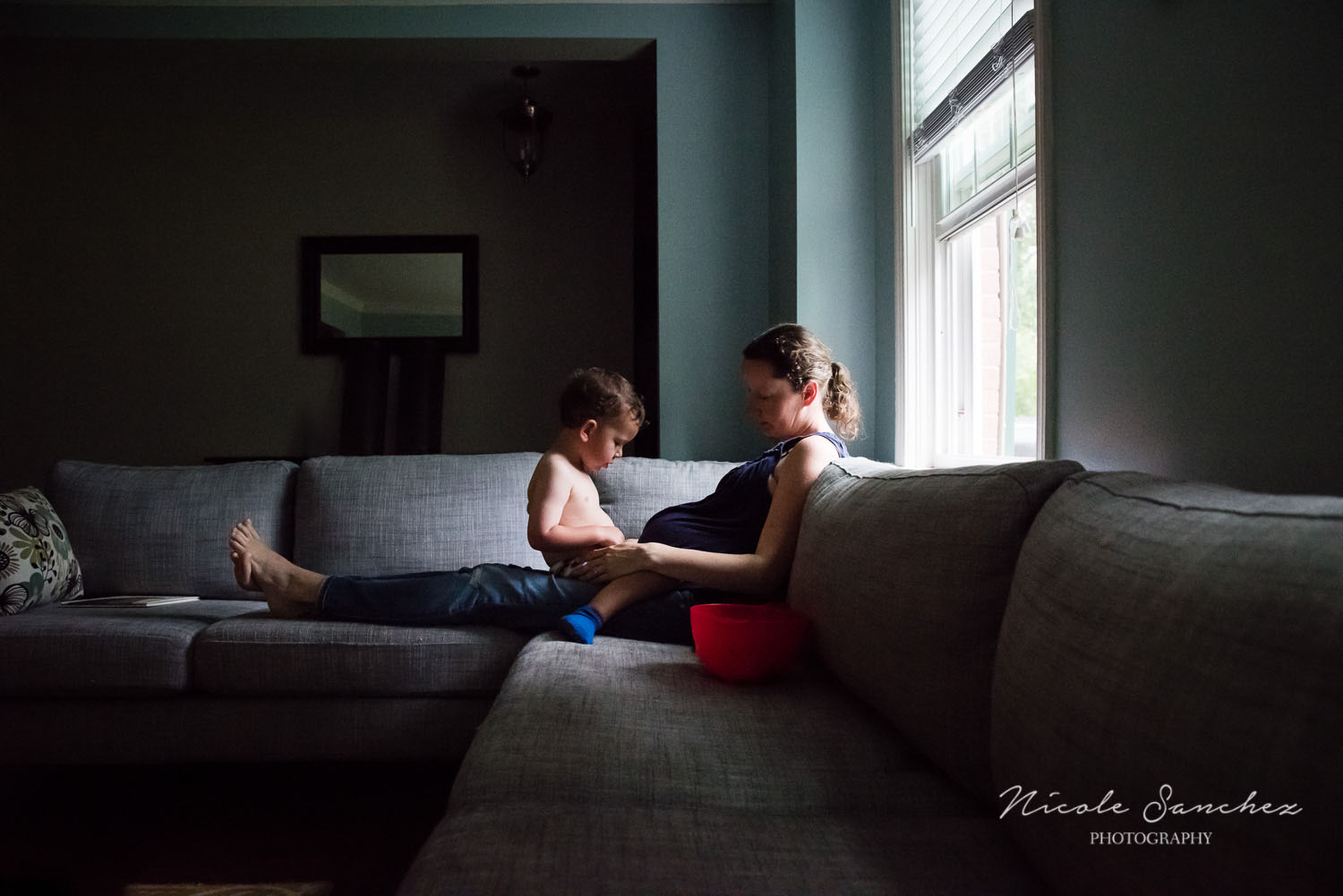 Maternity Self-Portrait Reading on Couch