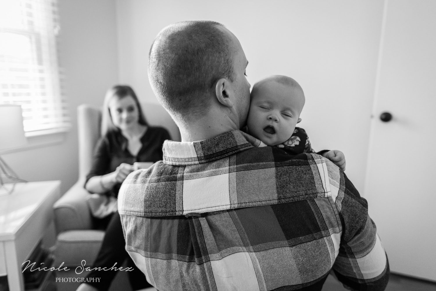 Dad holding baby daughter in nursery | Northern Virginia Family Photographer