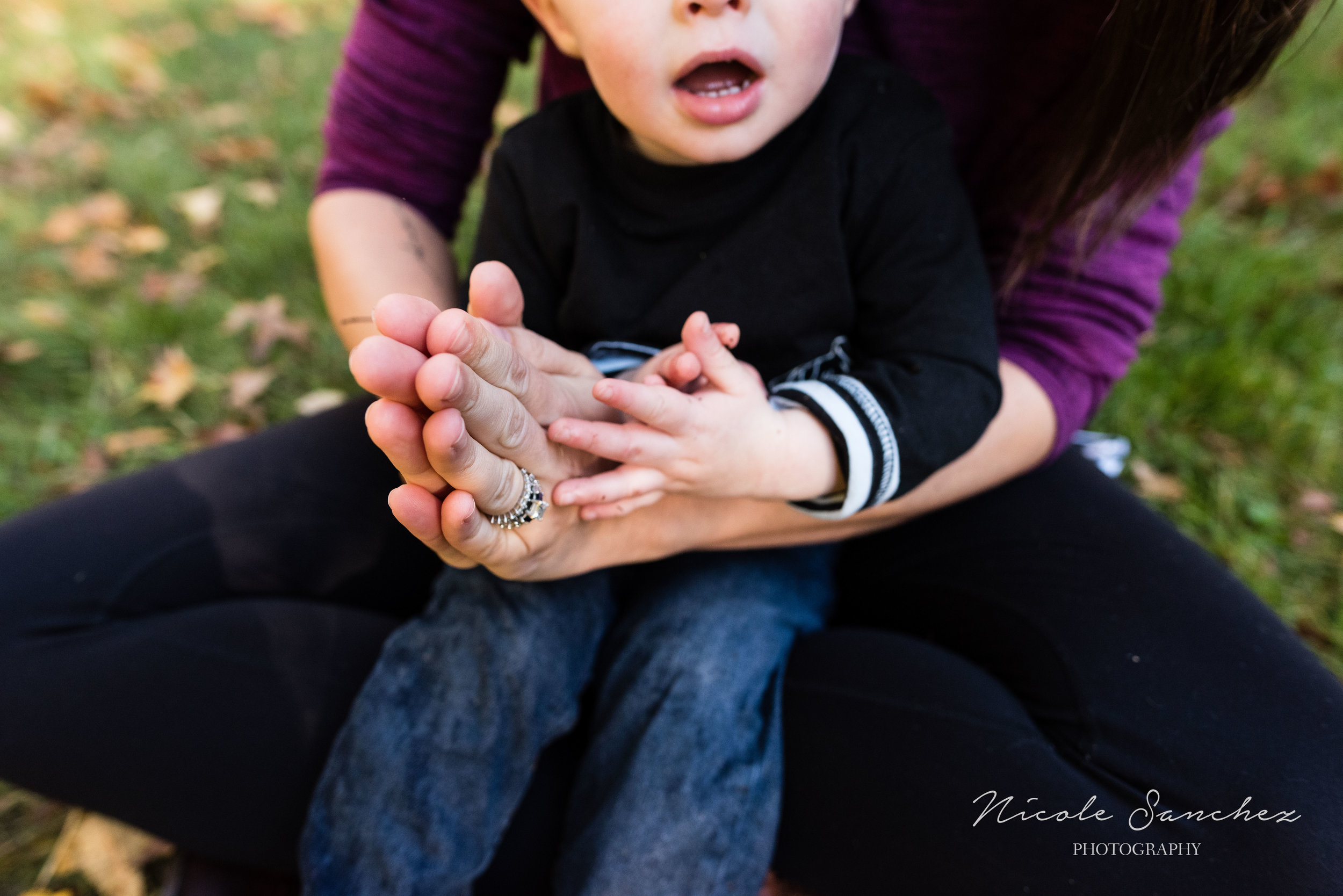 Mom holding hands with son | Alexandria, VA Family Photographer