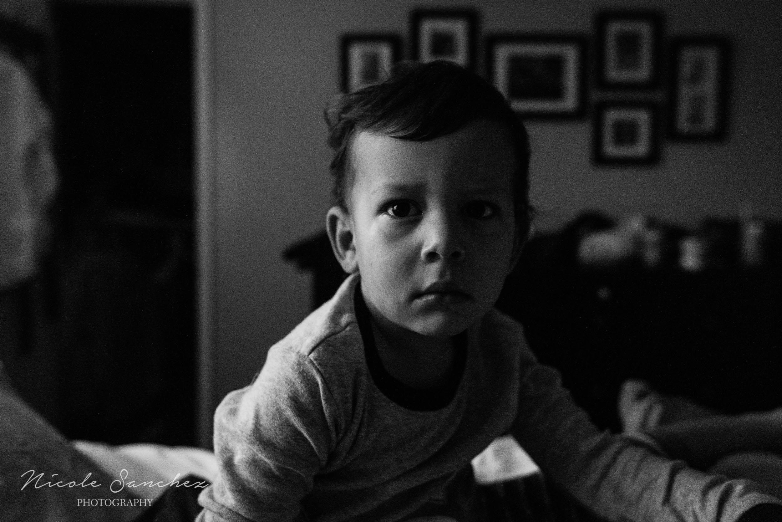Portrait of sleepy boy just waking up in Northern Virginia by Nicole Sanchez Photography