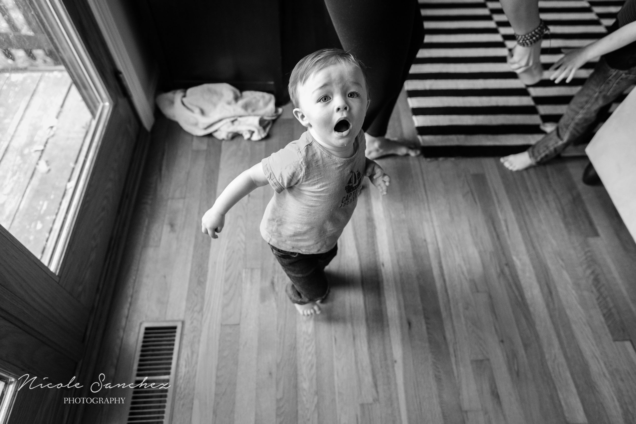 Boy on the run at in-home session in Northern Virginia by Family Photographer Nicole Sanchez