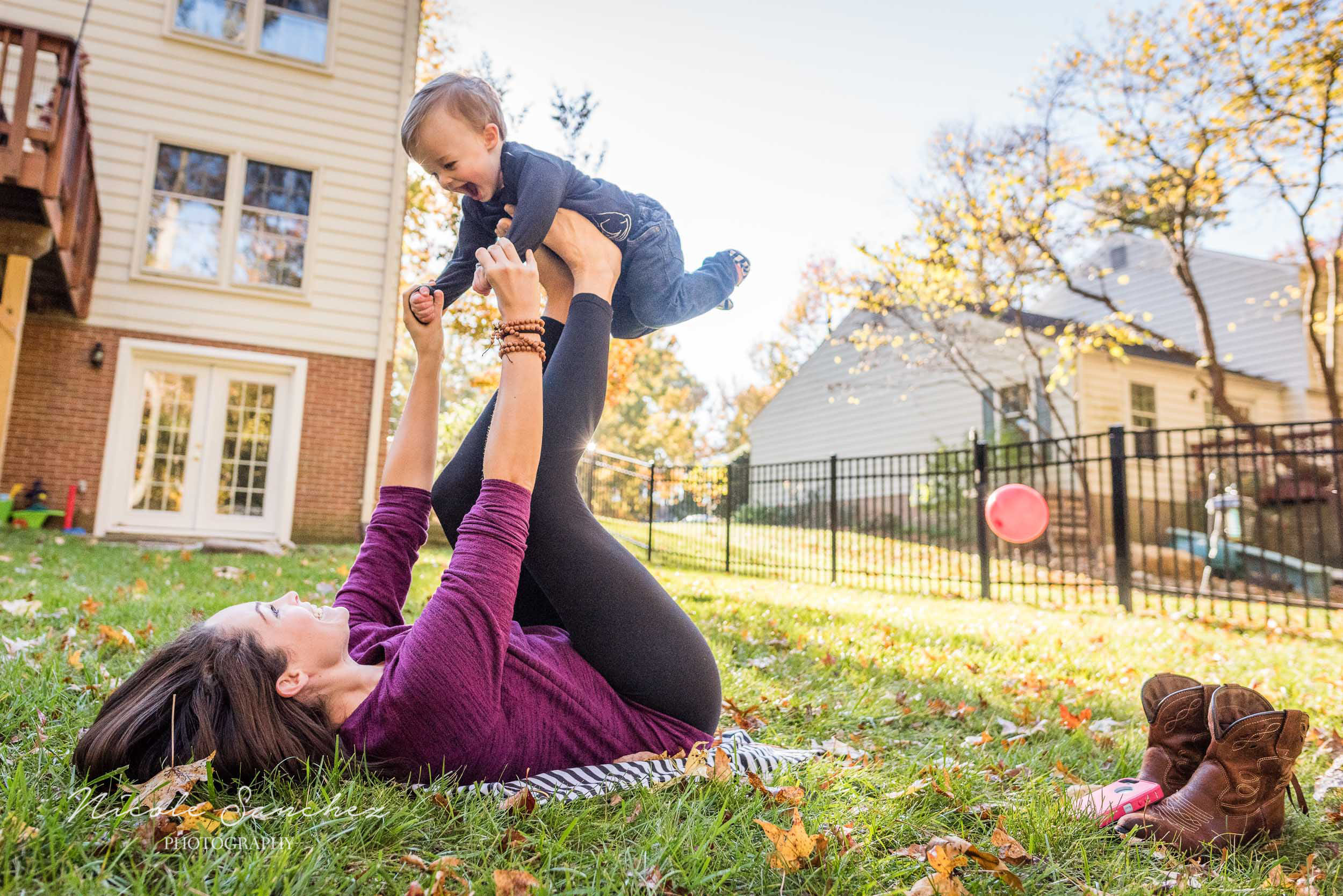 Mom and son superman at outdoor session in Northern Virginia by Lifestyle Family Photographer Nicole Sanchez