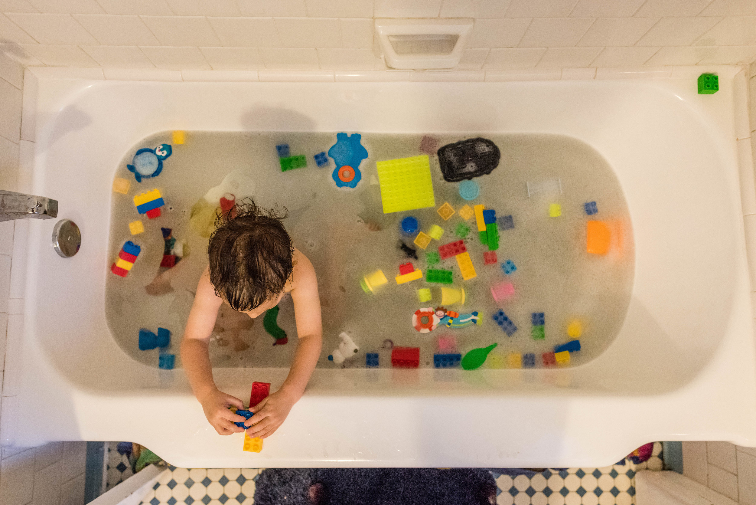 Boy playing with legos in bath by Northern Virginia Family Photographer Nicole Sanchez