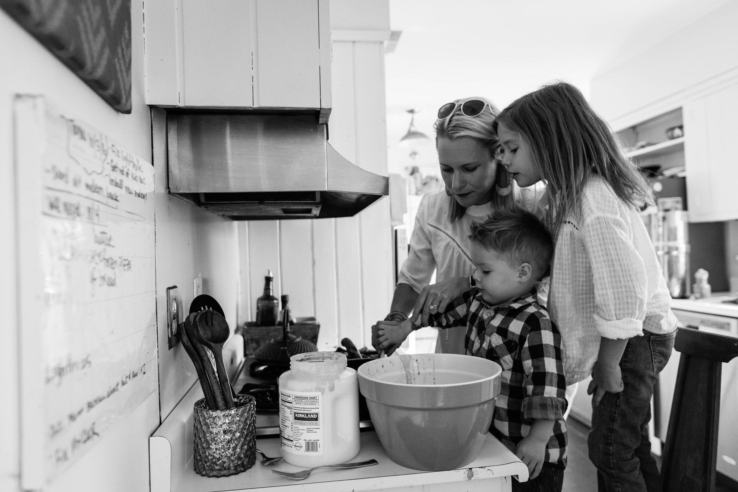 Mom cooking pancakes with children by Alexandria, VA Family Photographer Nicole Sanchez