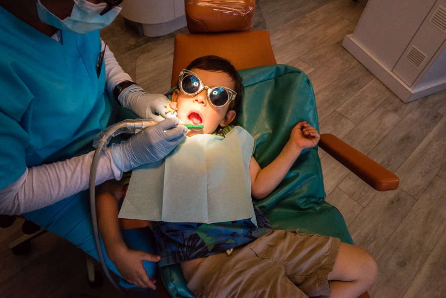 child-getting-teeth-cleaned-by-northern-virginia-family-photographer-nicole-sanchez
