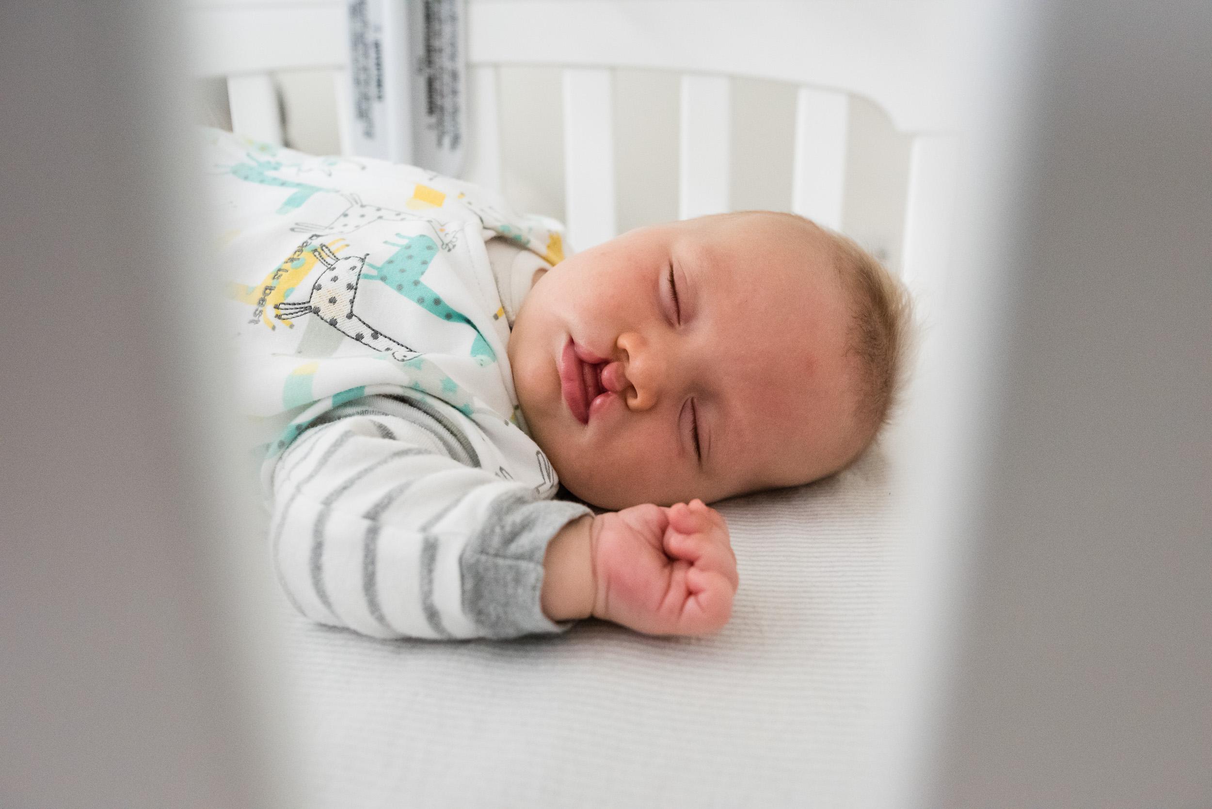 Baby boy sleeping in crib in Washington, DC by Family Photographer Nicole Sanchez