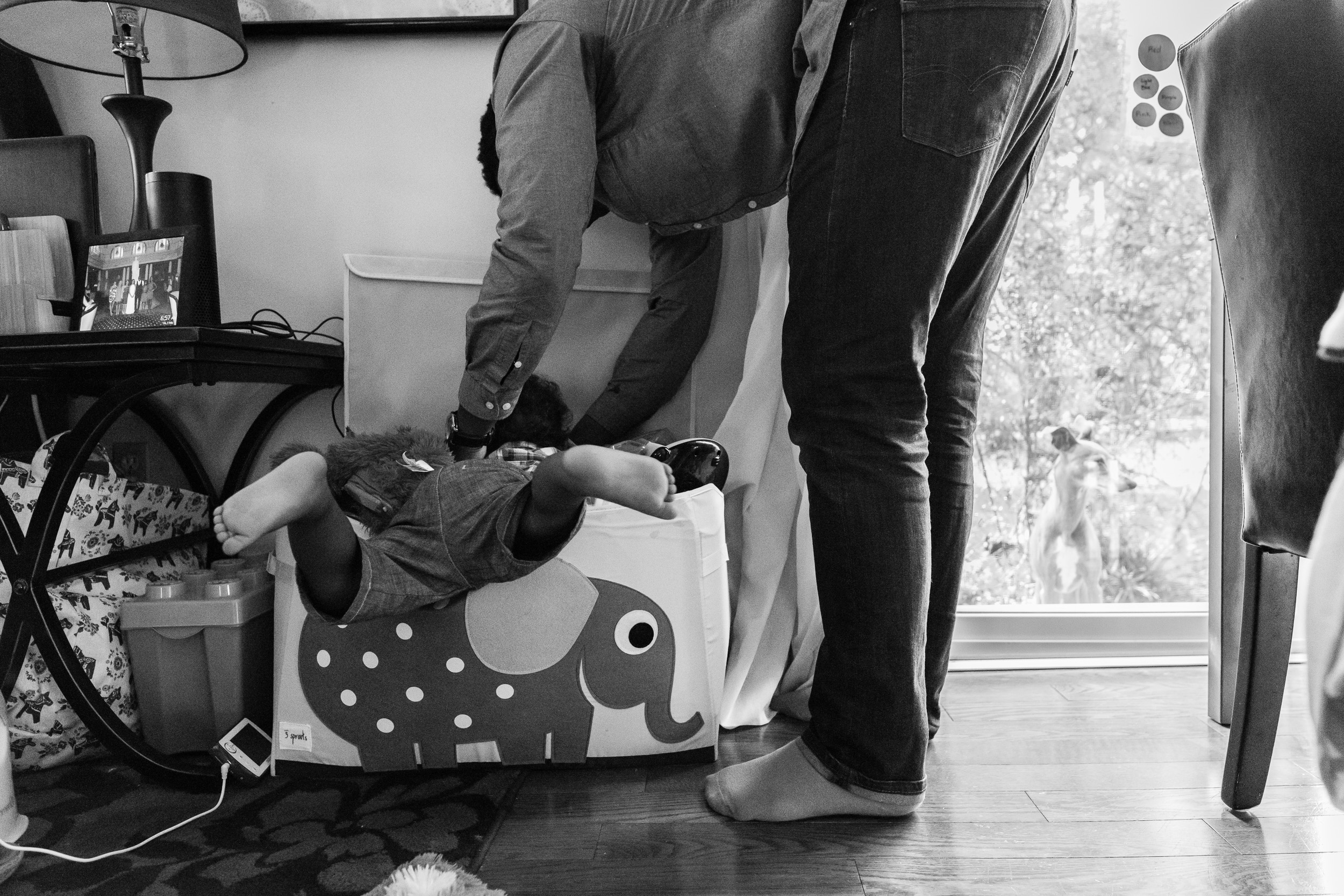 Dad helping son look for toys in bin by Northern Virginia Family Photographer Nicole Sanchez