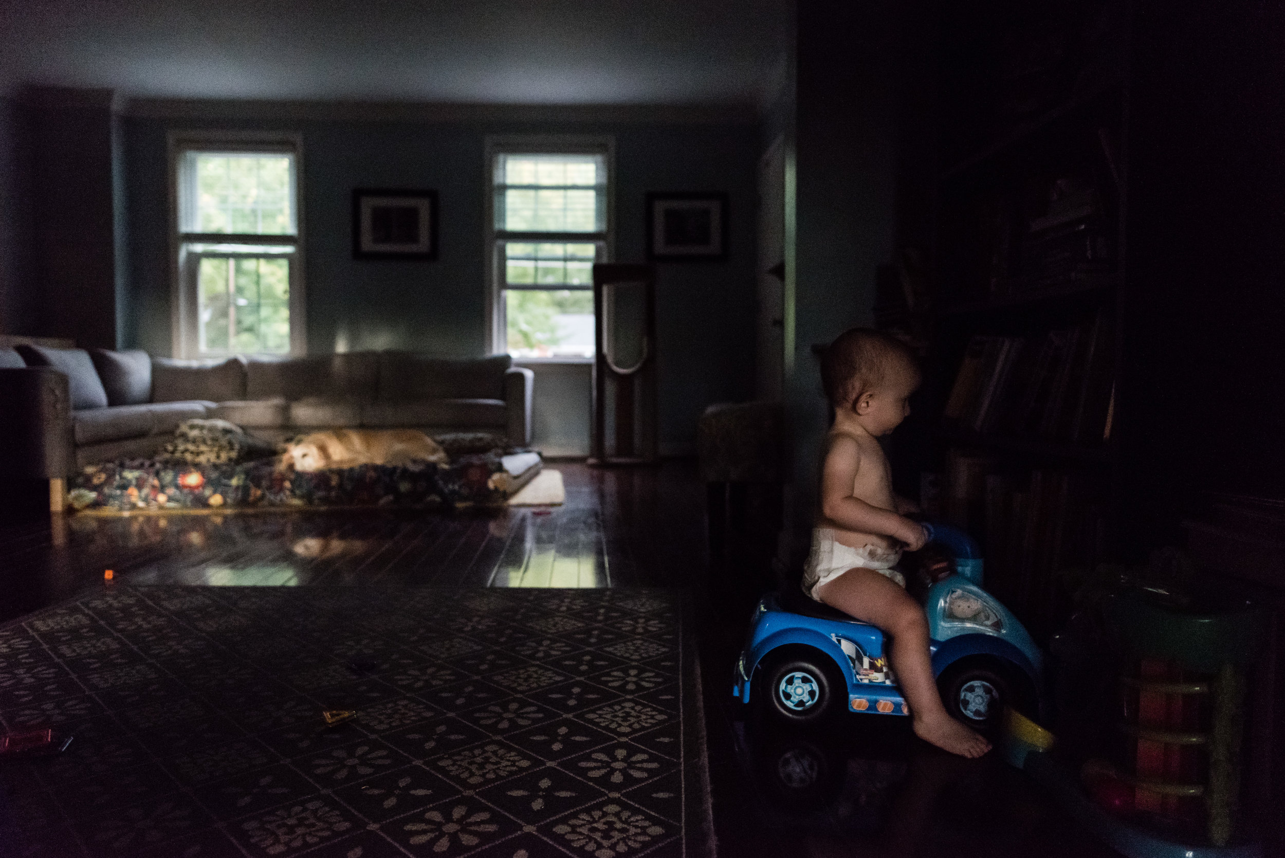 baby riding toy car by northern virginia family photographer nicole sanchez