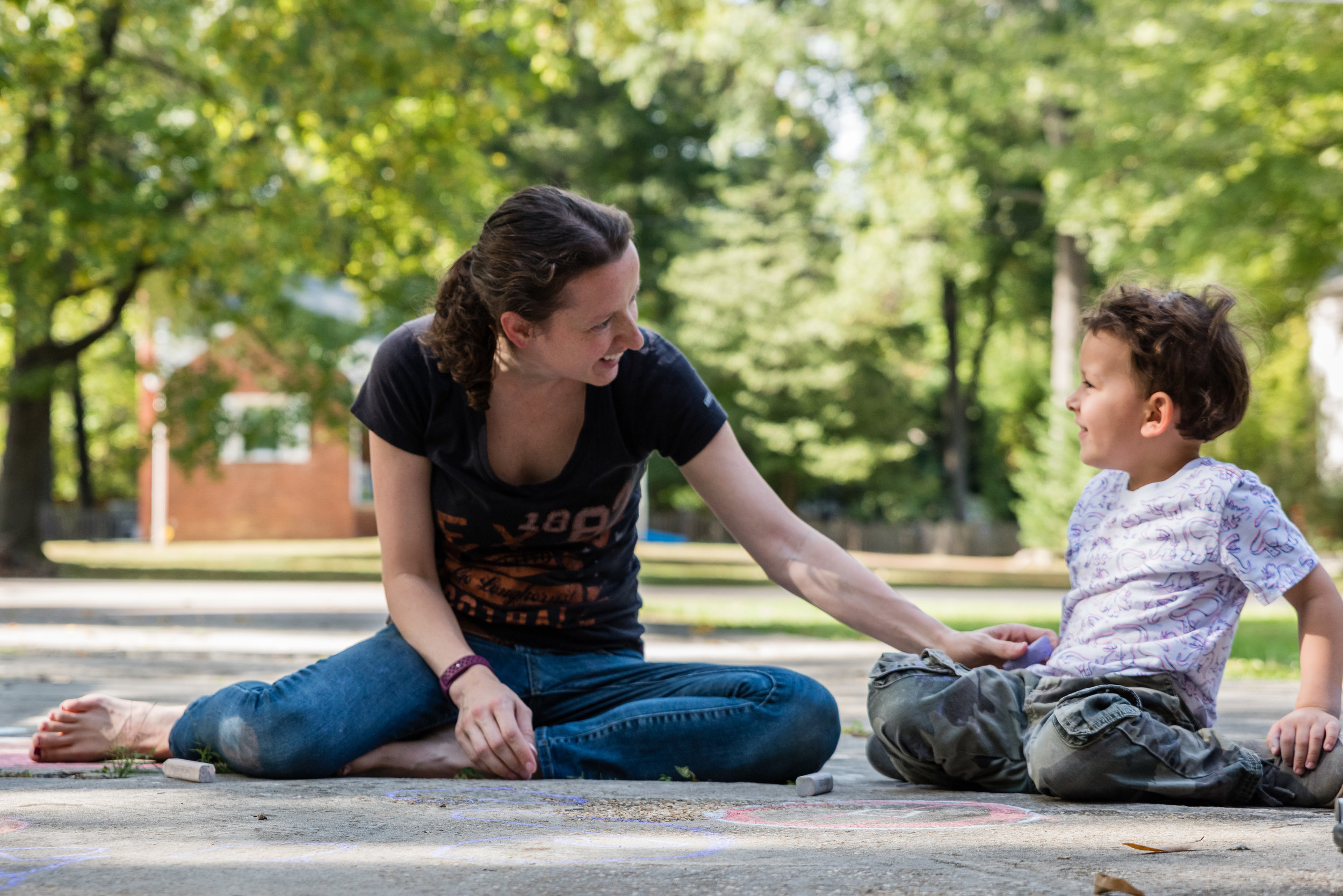 mom and son drawing with sidewalk chalk by northern virginia family photographer nicole sanchez