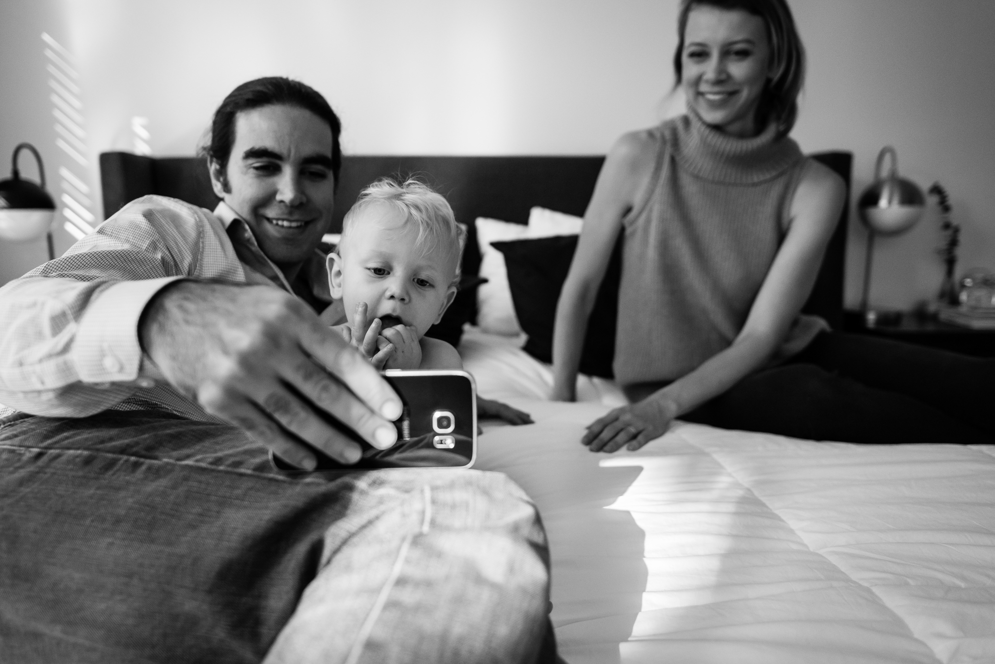 Parents playing with baby and smart phone by Washington, DC Family Photographer Nicole Sanchez