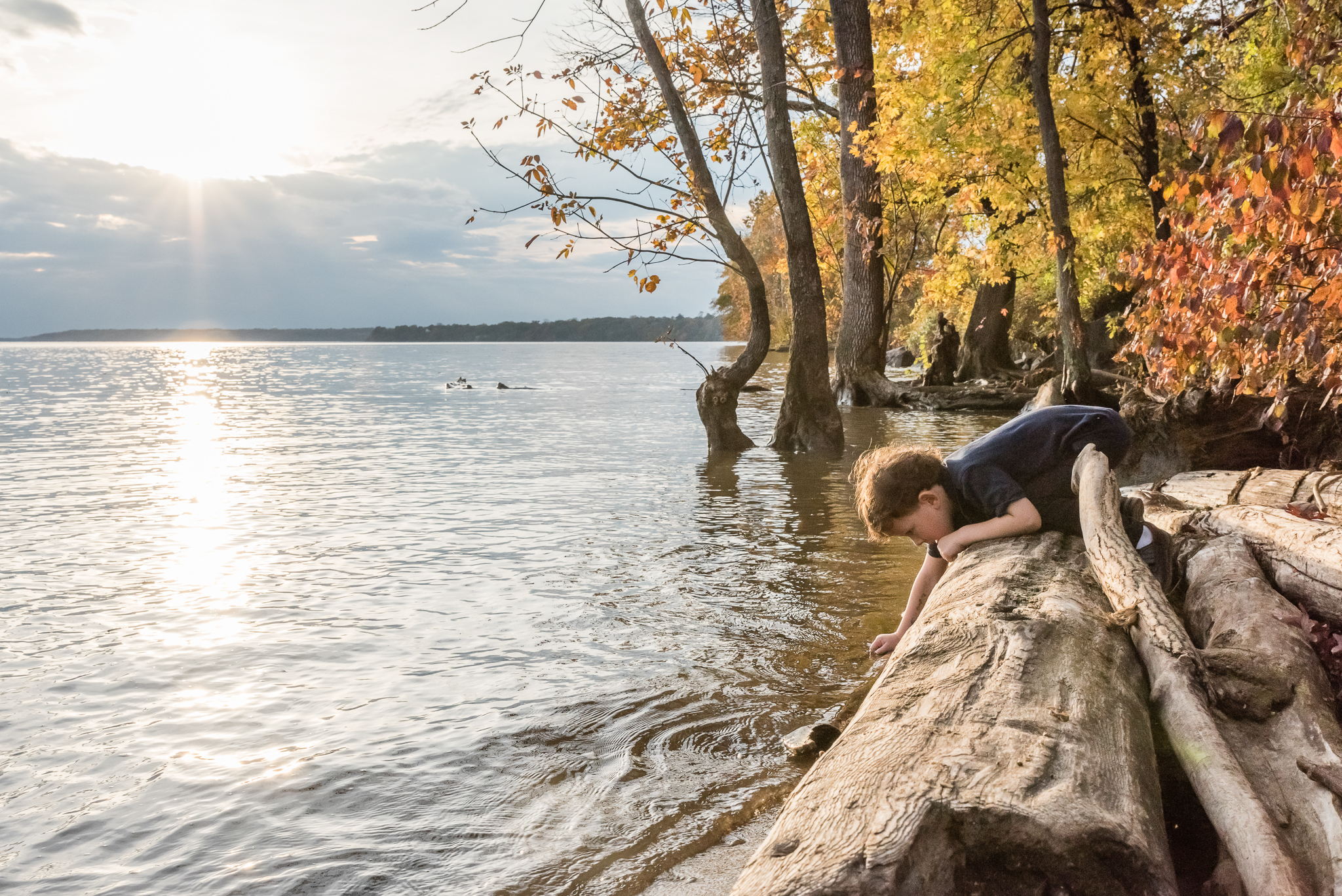 Boy playing in Potomac River by Northern Virginia Family Photographer Nicole Sanchez