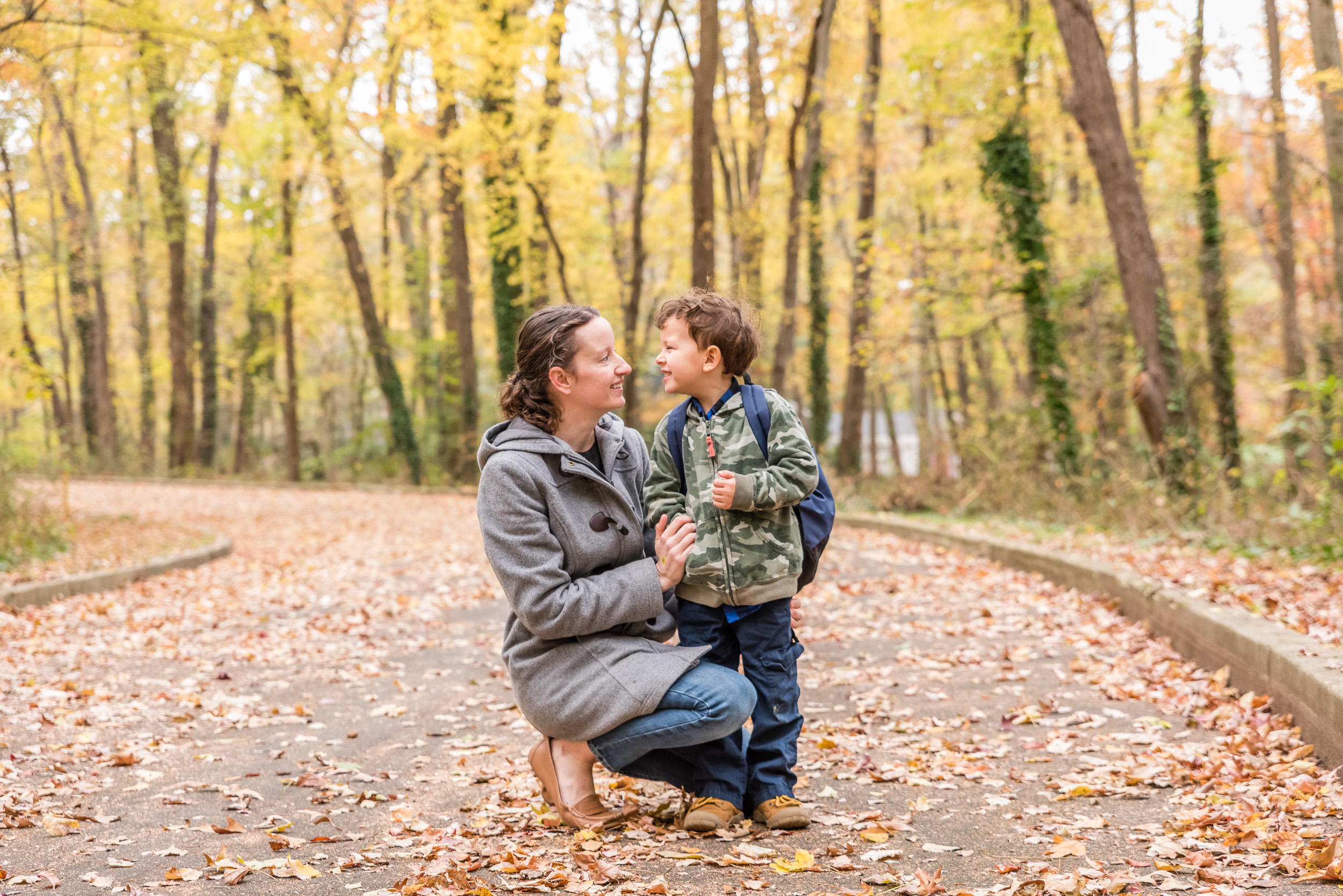 Mom and son with autumn leaves by Northern Virginia Family Photographer Nicole Sanchez