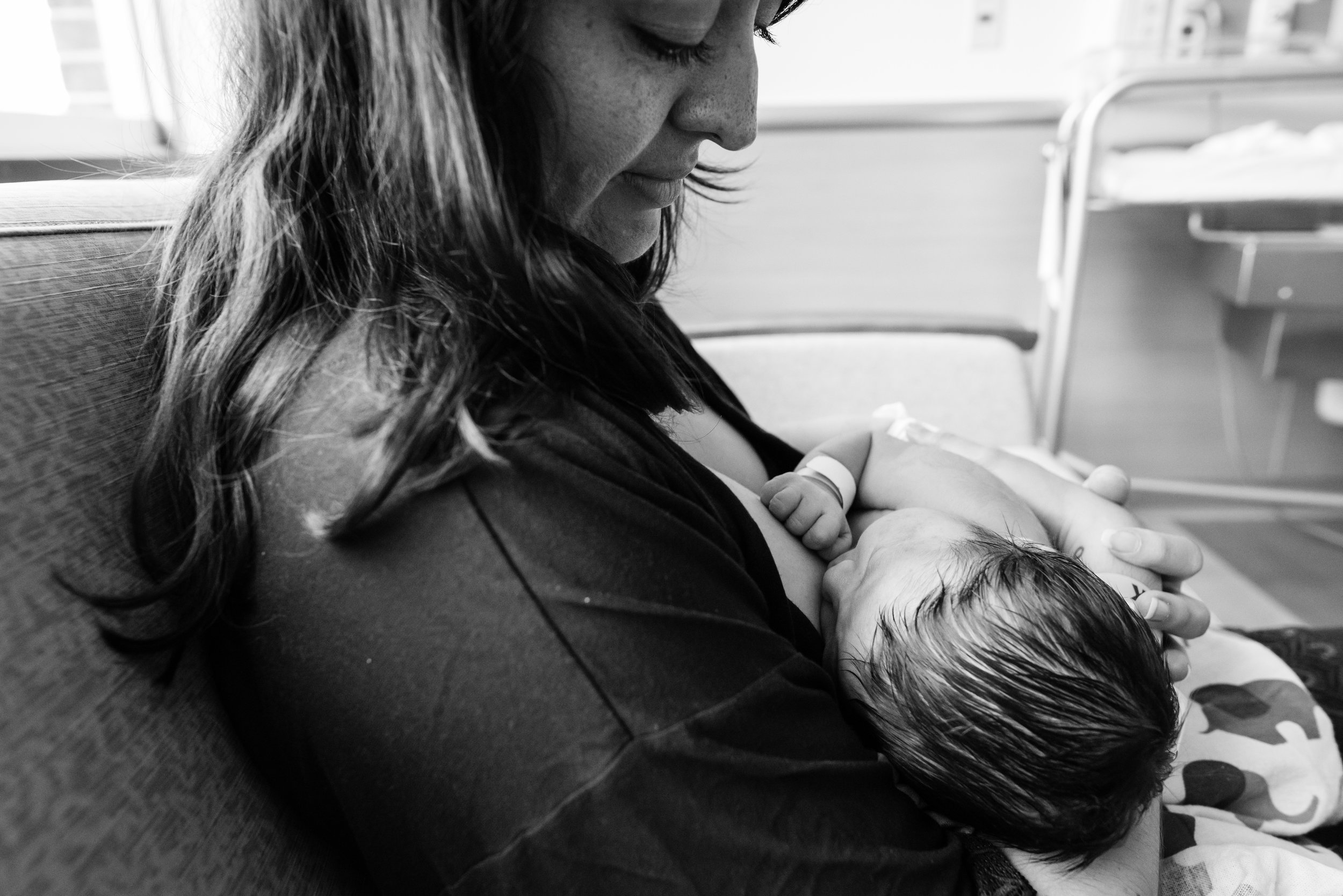 Newborn baby breastfeeding contentedly in hospital by Northern Virginia Newborn Photographer Nicole Sanchez