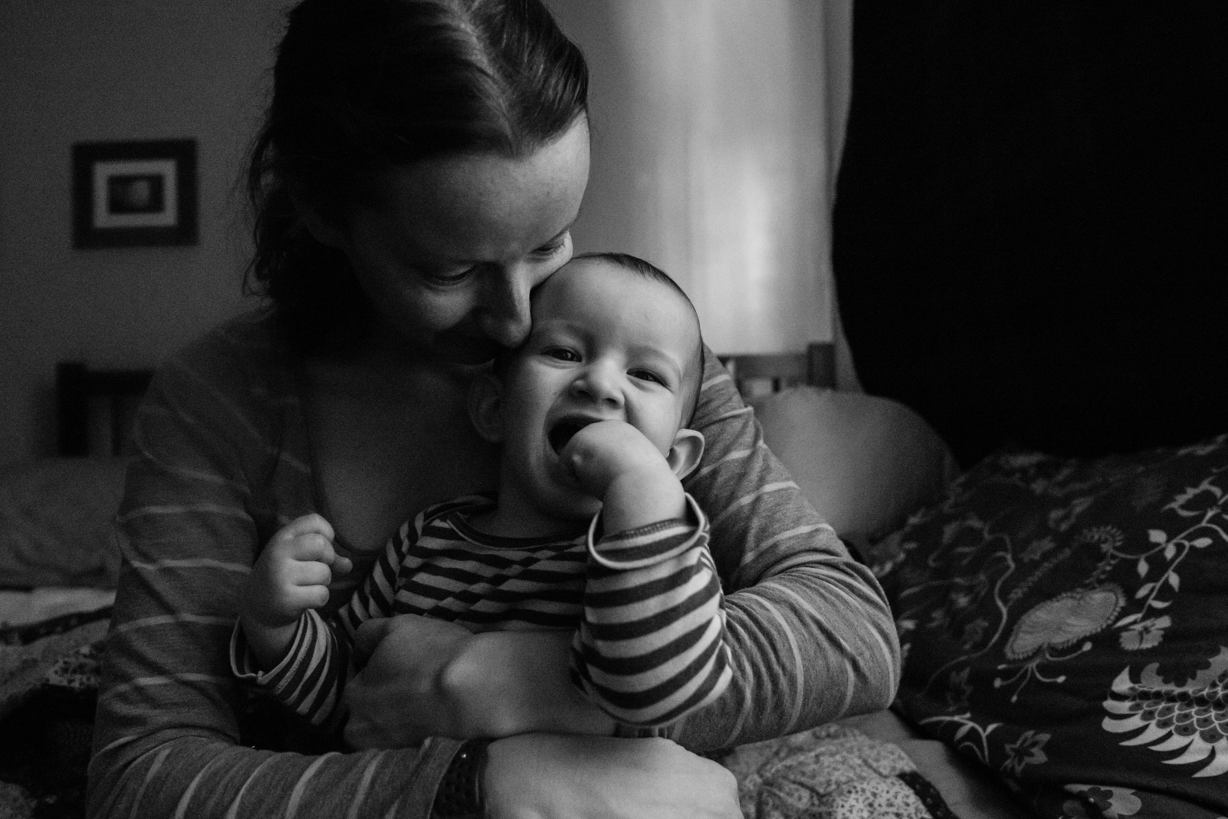 Mom hugging laughing son