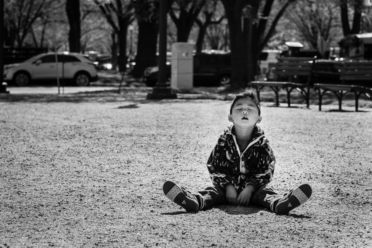 Boy taking a break on National Mall by Washington, D.C. Family Photographer Nicole Sanchez