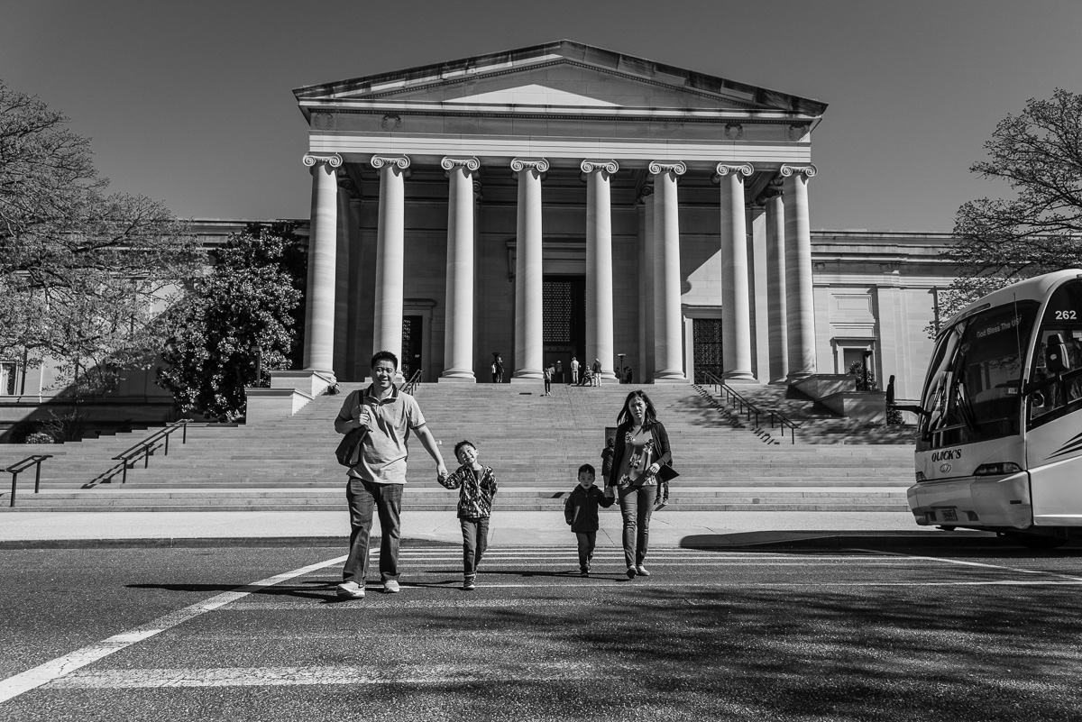 Family walking in front of National Gallery of Art in Washington, D.C.