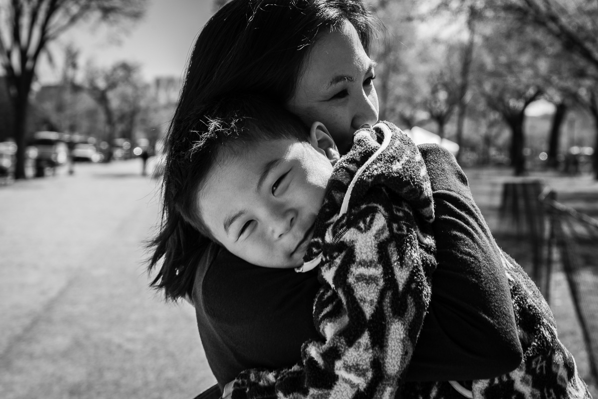 Mom holding son on vacation in Washington, D.C. by Nicole Sanchez Photography