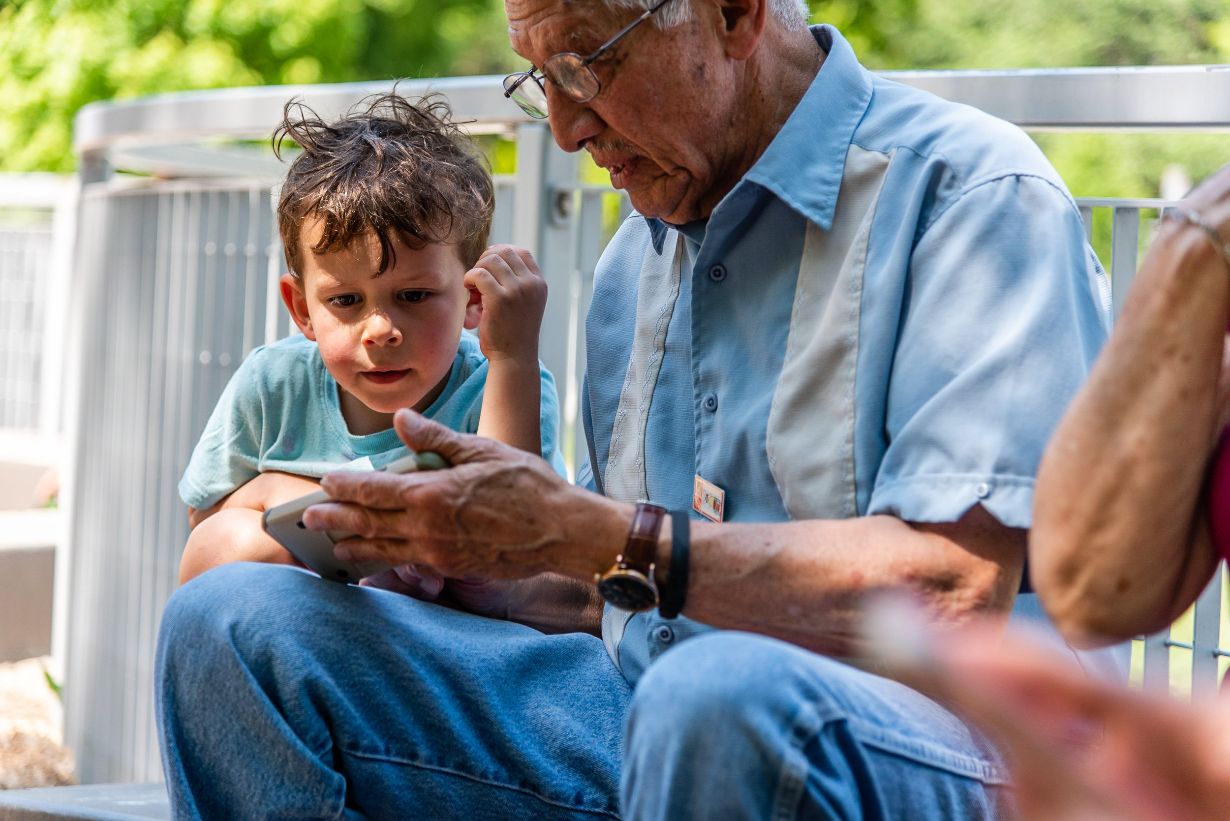 Grandfather and grandson with cell phone by Northern Virginia Family Photographer Nicole Sanchez