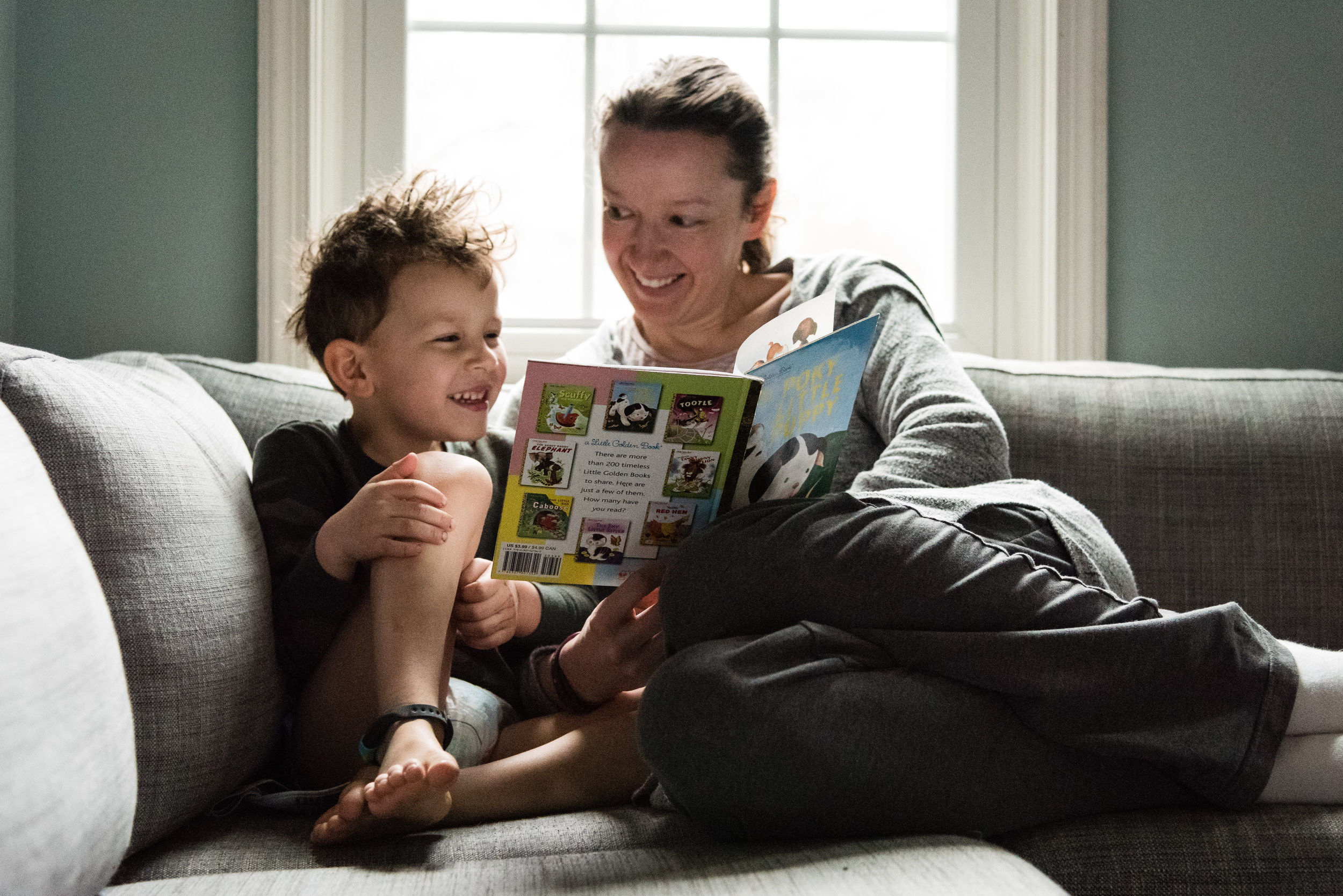 Mother and son self-portrait reading a book by Northern Virginia Family Photographer Nicole Sanchez