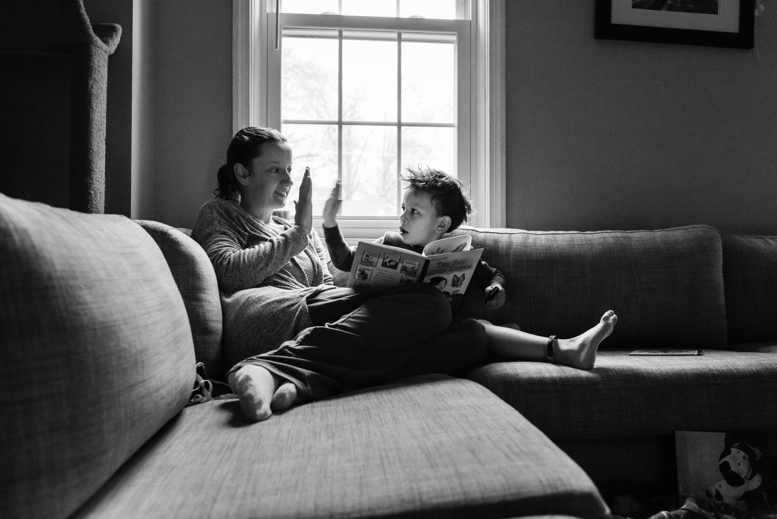 Mother and son self-portrait high-fives by Northern Virginia Family Photographer Nicole Sanchez