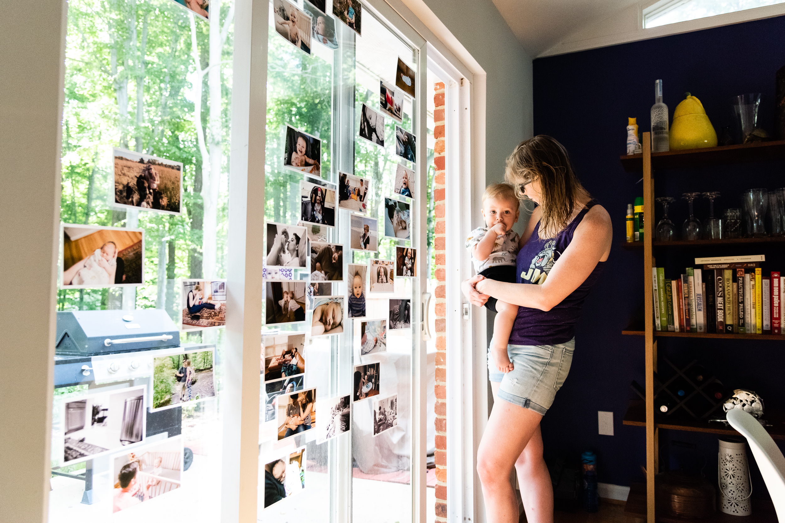 Mom holding baby at window by northern virginia family photographer nicole sanchez