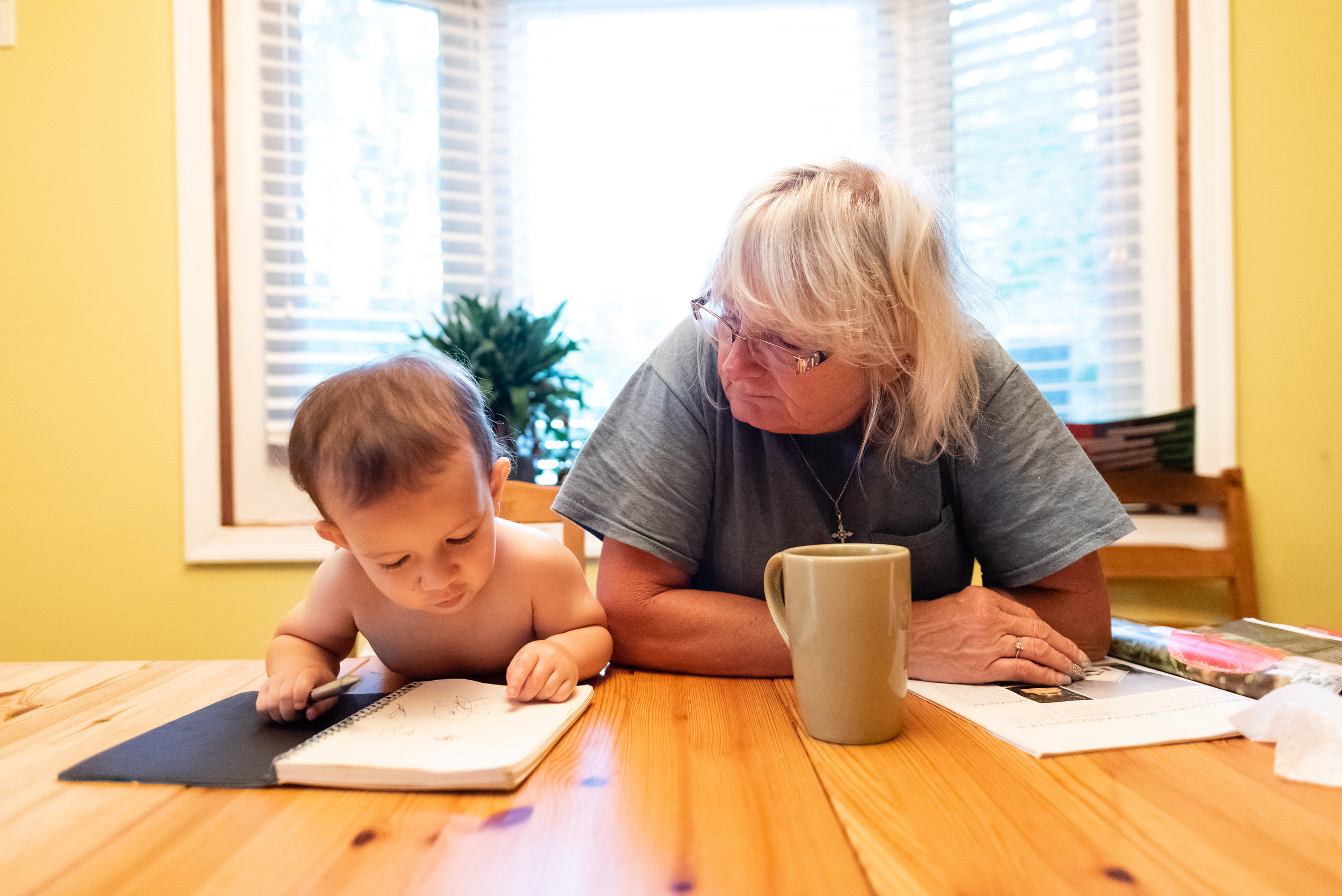 Grandma and toddler enjoying breakfast together by Northern Virginia Family Photographer Nicole Sanchez