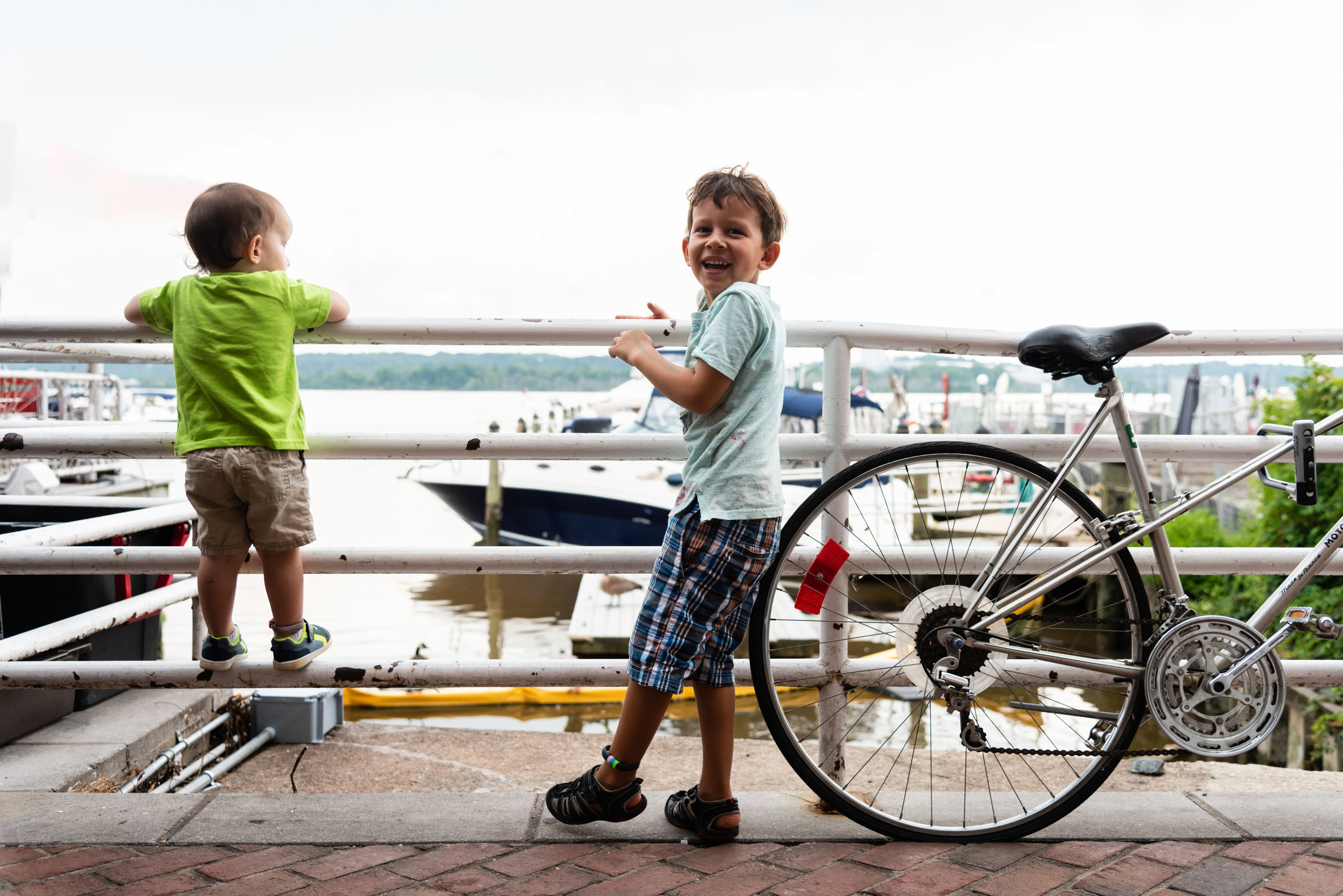 Brothers looking at Old Town Alexandria Marina by Northern Virginia Family Photographer Nicole Sanchez