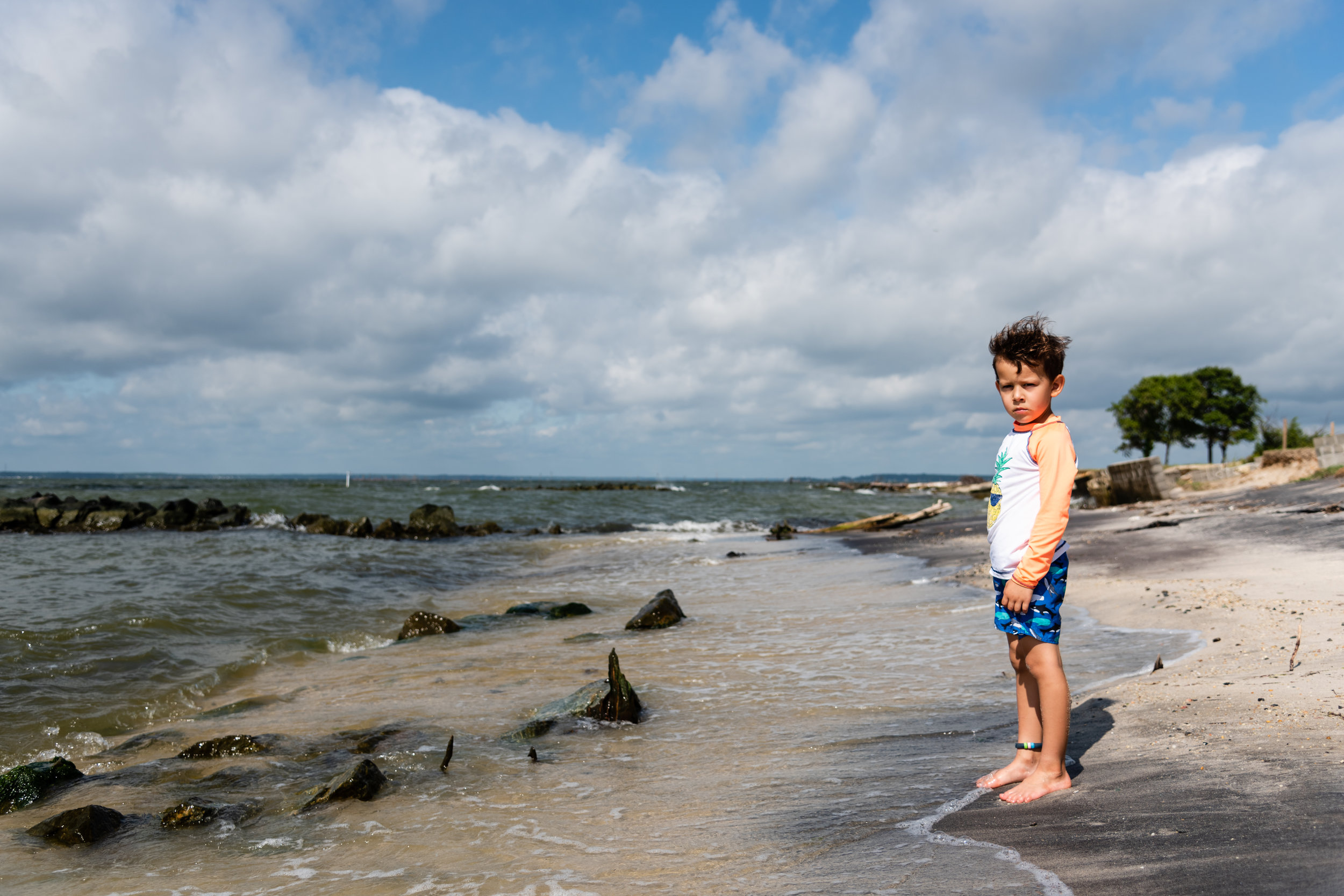 Boy on beach by Northern Virginia Family Photographer Nicole Sanchez