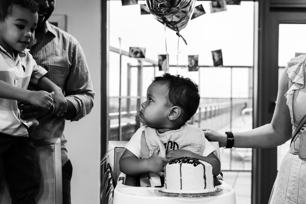 Baby worried about big brother taking his cake by Northern Virginia Family Photographer Nicole Sanchez
