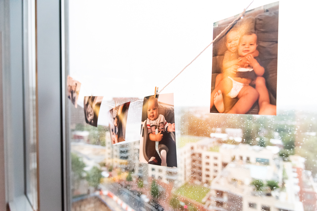 Baby photos as decoration at birthday party by Northern Virginia Family Photographer Nicole Sanchez