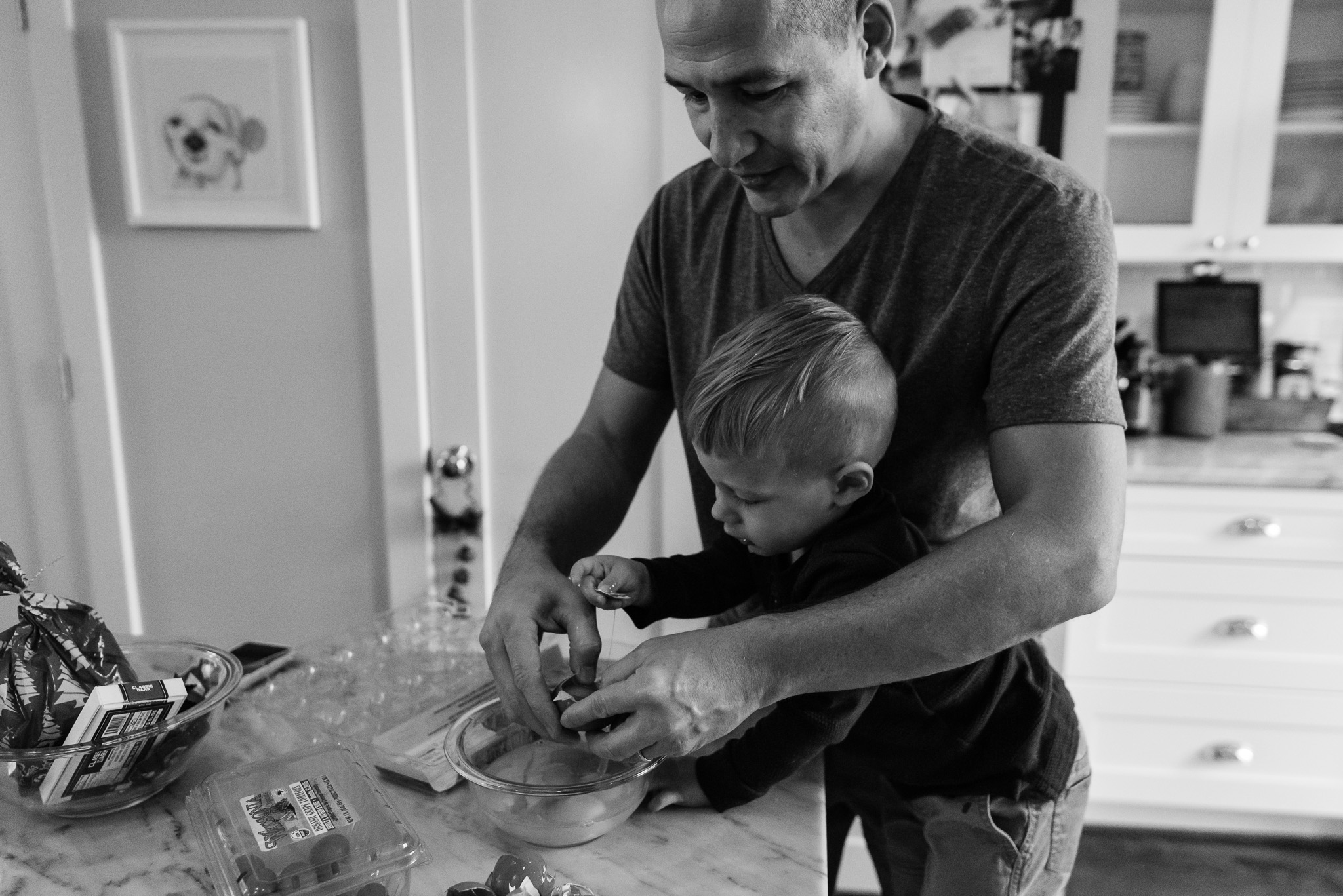 Father and toddler baking for Christmas