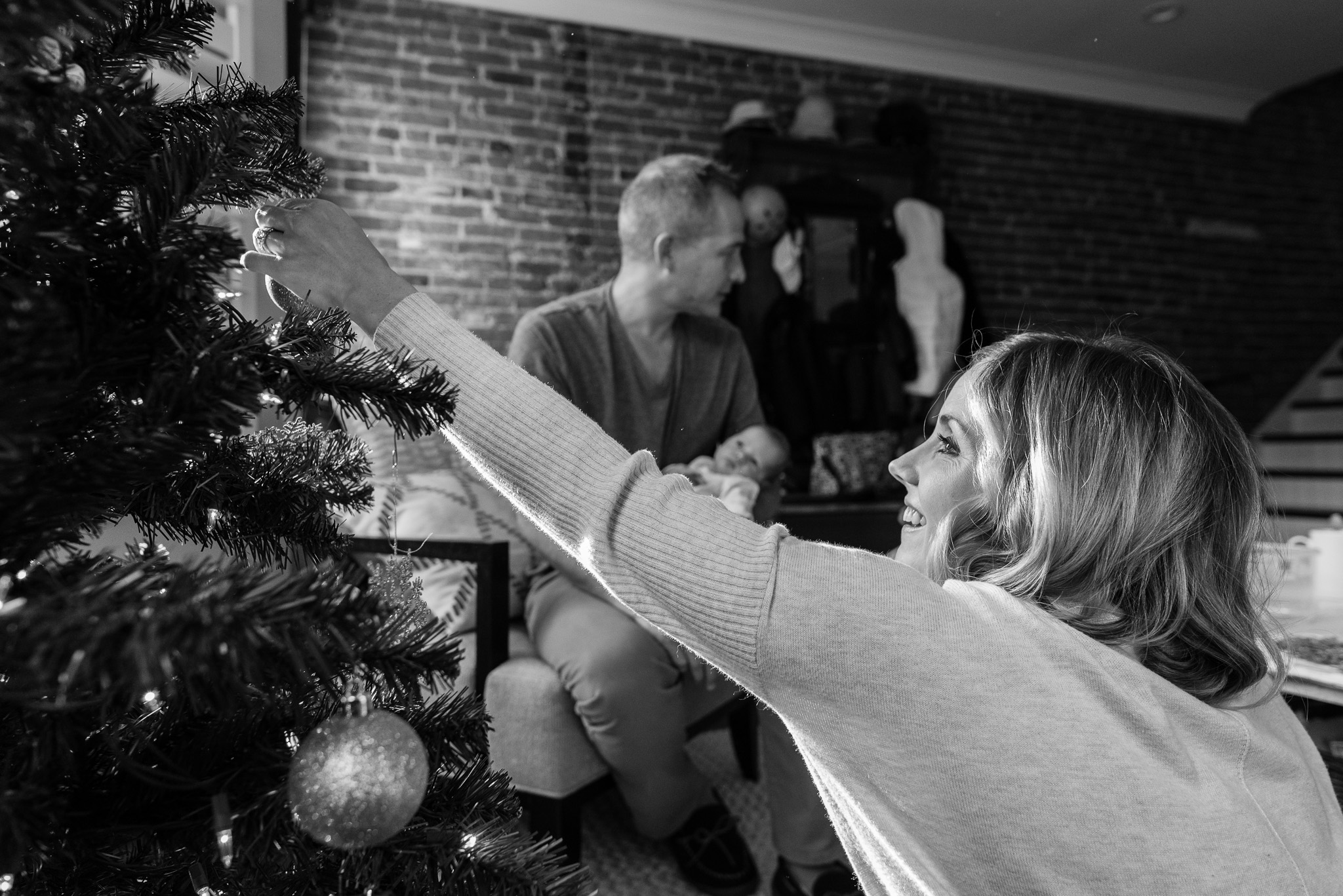 Family decorating Christmas tree together in Washington, DC